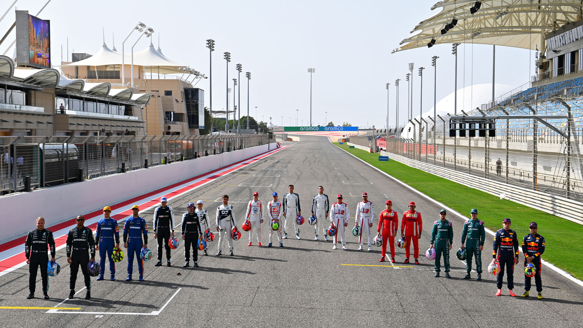 BAHRAIN, BAHRAIN - MARCH 12: The F1 drivers stand on the grid during Day One of F1 Testing at Bahrain International Circuit on March 12, 2021 in Bahrain, Bahrain. (Photo by Clive Mason - Formula 1/Formula 1 via Getty Images)