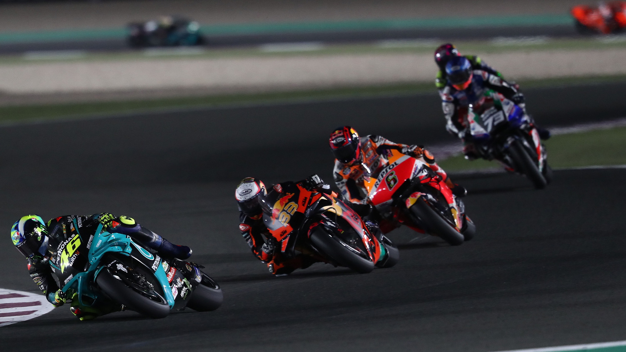 Valentino Rossi chased by Brad Binder Stefan Bradl and Alex MArquez in the 2021 MotoGP Qatar GP