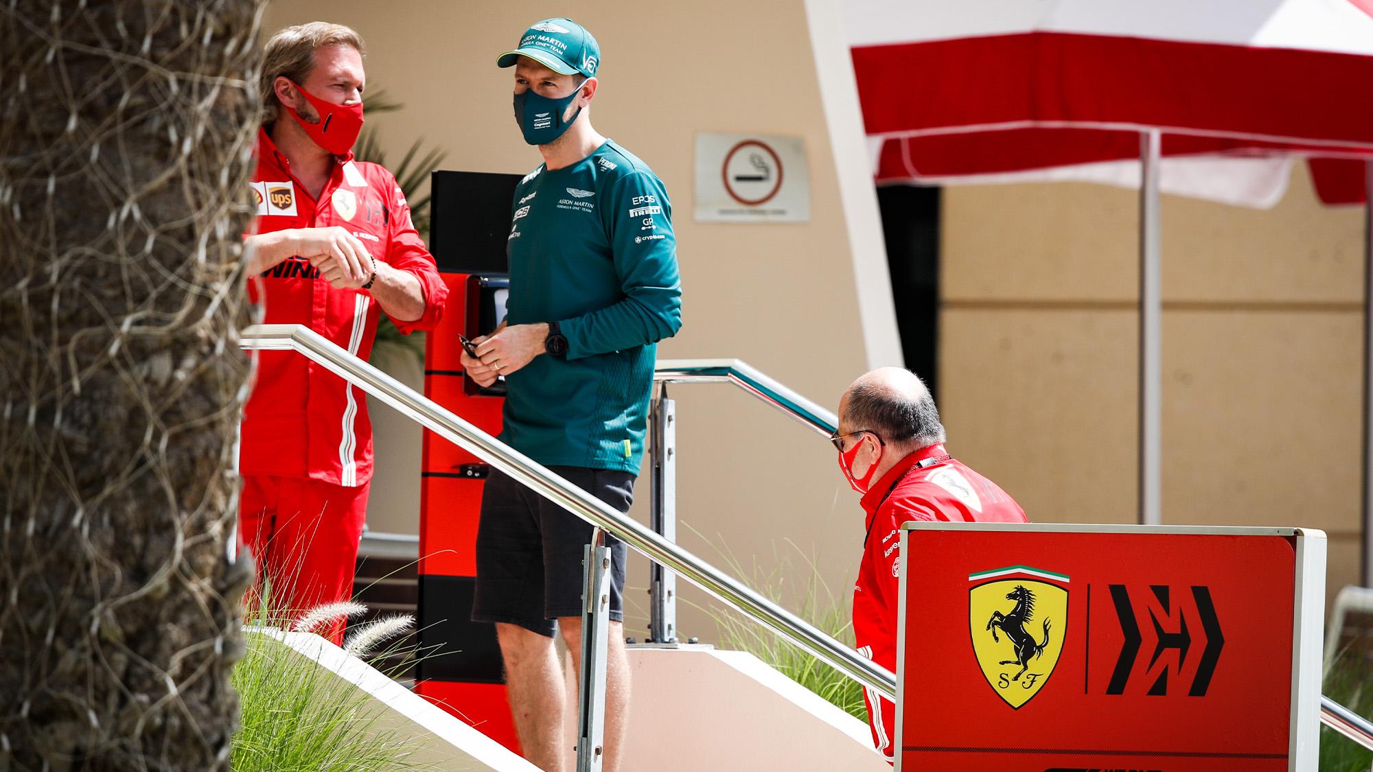 Sebastian Vettel speaks to Ferrari team members at the 2021 Bahrain Grand Prix