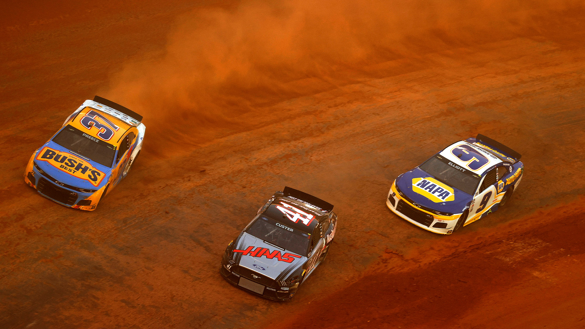 NASCAR Cup racers on the dirt at Bristol Speedway in 2021