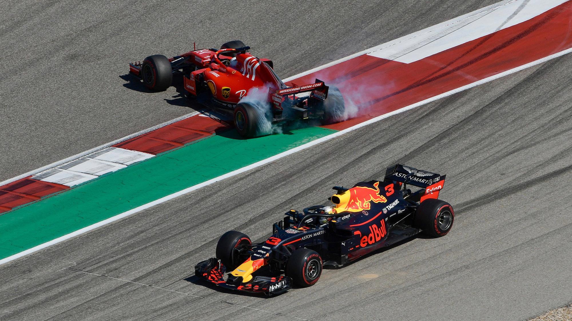 Sebastian Vettel spins after hitting Daniel Ricciardo at the 2018 United States Grand Prix