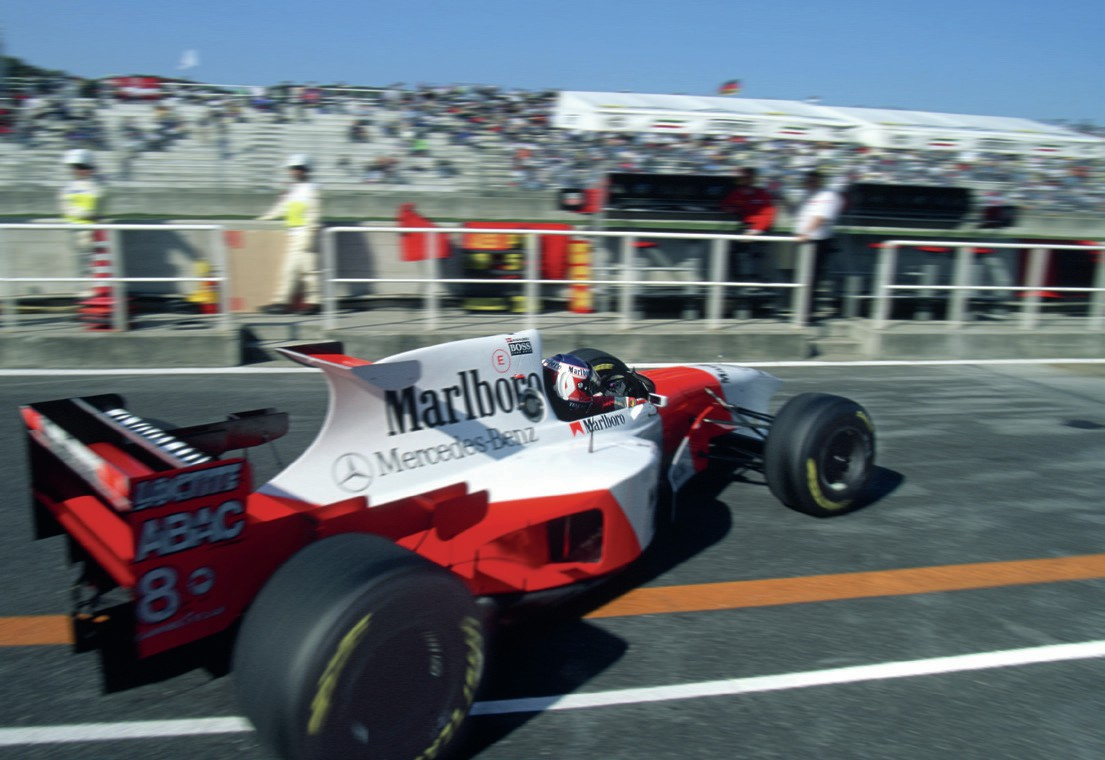 McLaren of Jan Magnussen pulls out of the pits in 1995