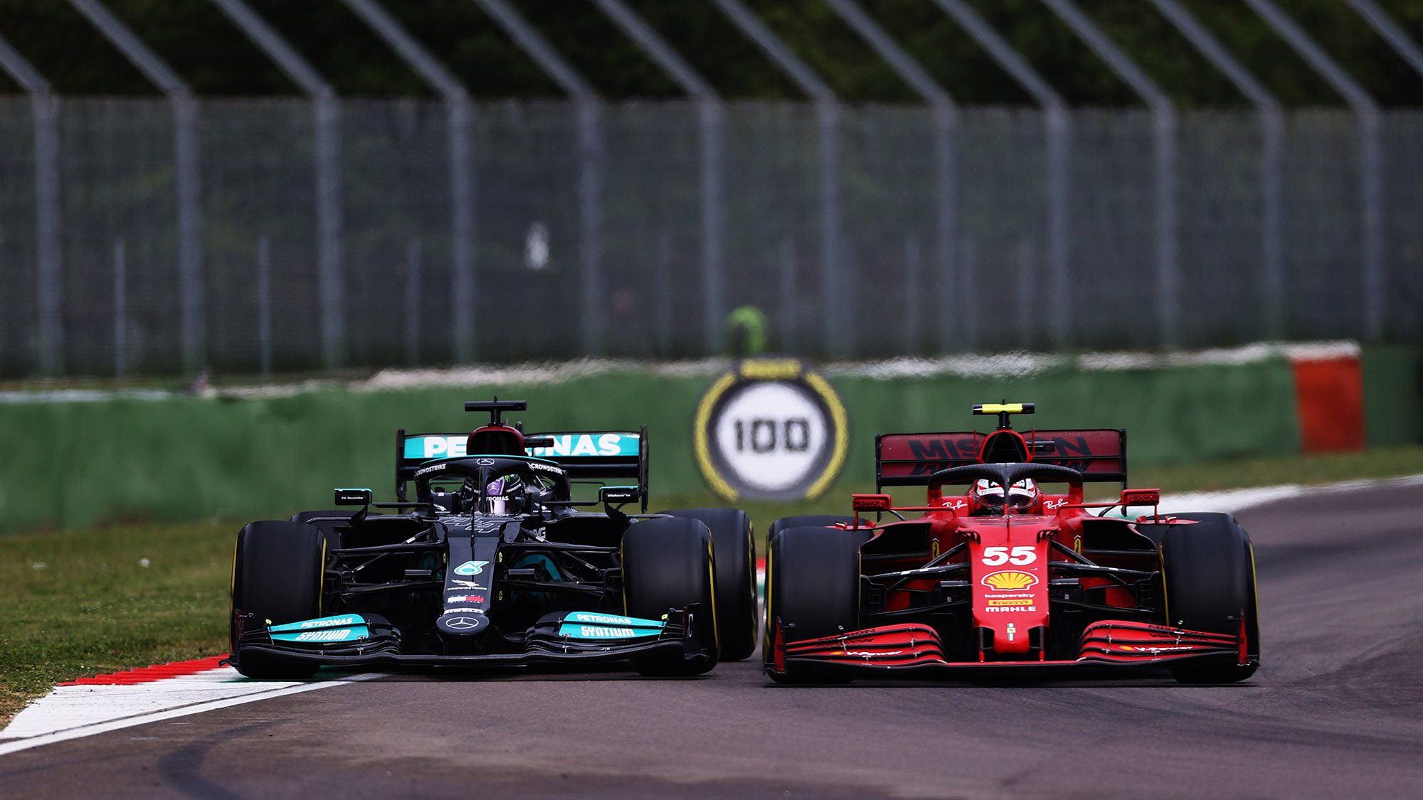 Lewis Hamilton battles with Carlos Sainz in the 2021 Emilia Romagna Grand Prix