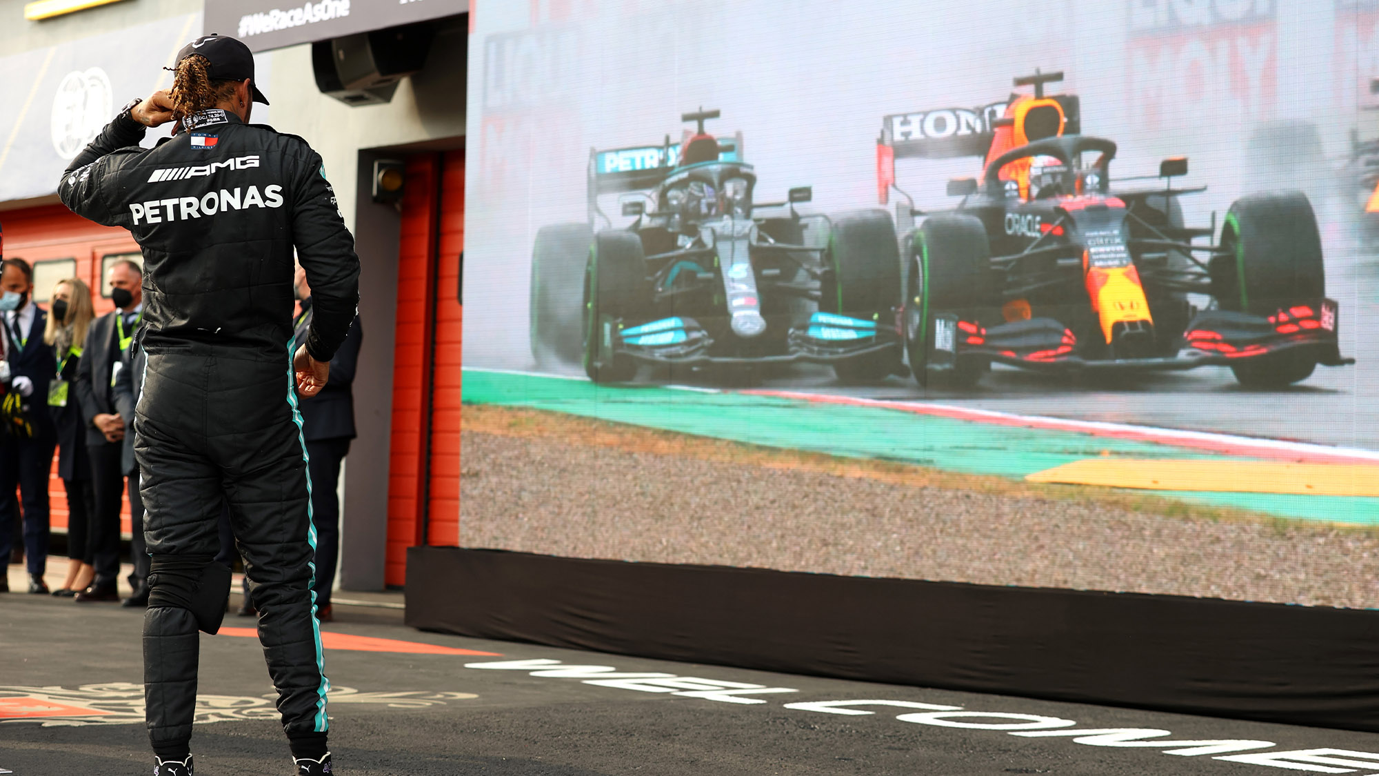 Lewis Hamilton watches his fight with Max Verstappen at the 2021 Emilia Romagna Grand Prix