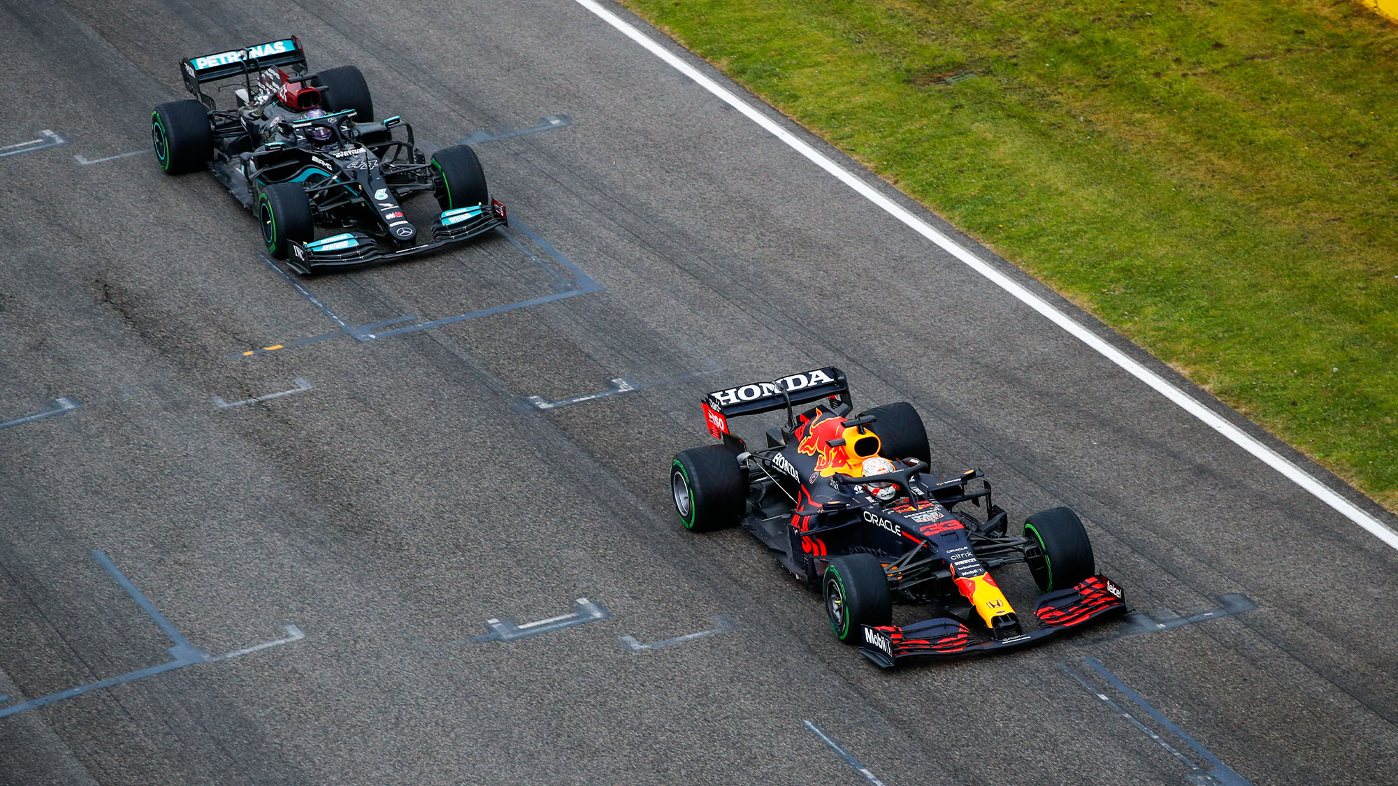 Max Verstappen leads Lewis Hamilton in the 2021 Emilia Romagna Grand Prix