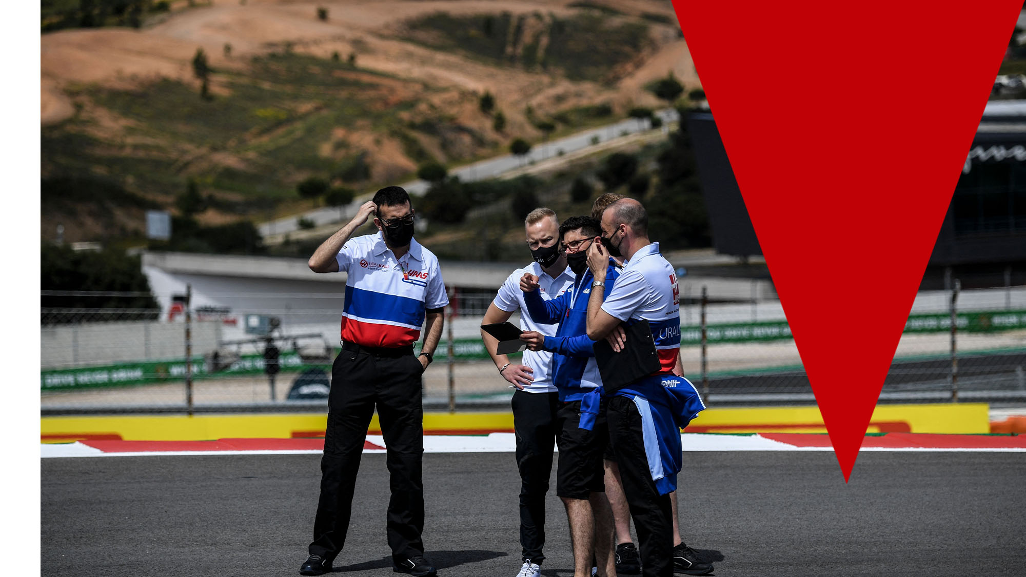 Haas F1's Russian driver Nikita Mazepin (2ndL) walks with team members at the Algarve International Circuit in Portimao on April 29, 2021 ahead of the Portuguese Formula One Grand Prix. (Photo by PATRICIA DE MELO MOREIRA / AFP) (Photo by PATRICIA DE MELO MOREIRA/AFP via Getty Images)