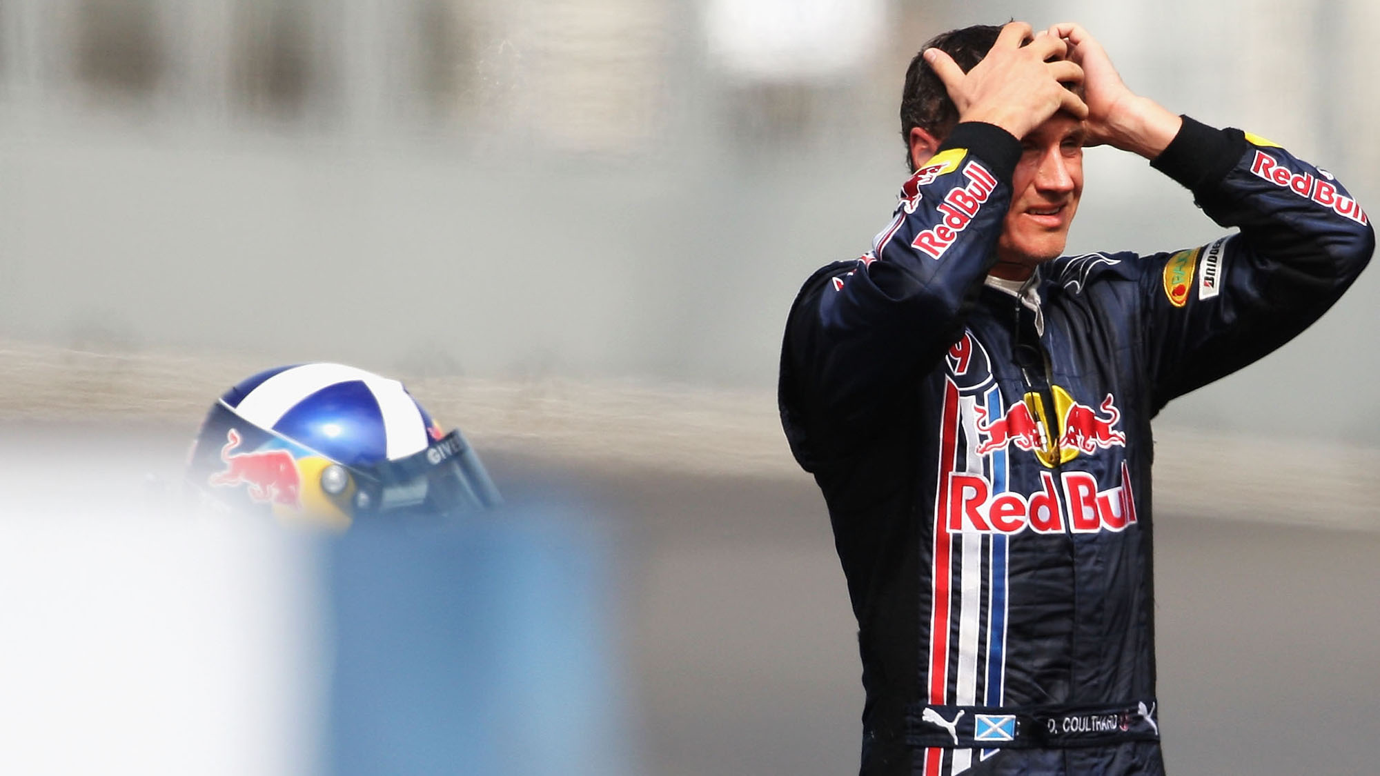 VALENCIA, SPAIN - AUGUST 22: David Coulthard of Great Britain and Red Bull Racing looks on after he crashes during practice for the European Formula One Grand Prix at the Valencia Street Circuit on August 22, 2008, in Valencia, Spain. (Photo by Bryn Lennon/Getty Images)