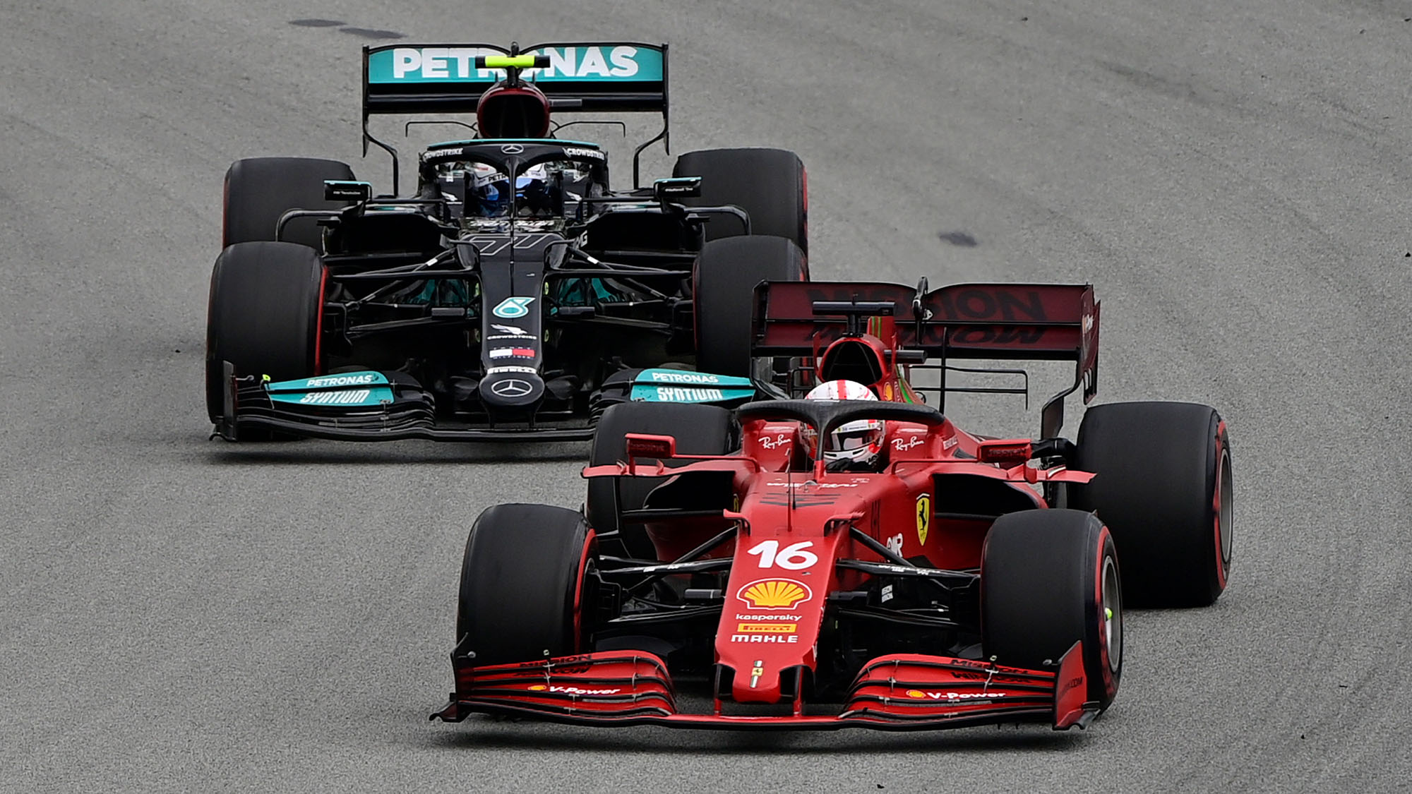 Ferrari's Monegasque driver Charles Leclerc drives ahead of Mercedes' Finnish driver Valtteri Bottas during the Spanish Formula One Grand Prix race at the Circuit de Catalunya on May 9, 2021 in Montmelo on the outskirts of Barcelona. (Photo by JAVIER SORIANO / AFP) (Photo by JAVIER SORIANO/AFP via Getty Images)