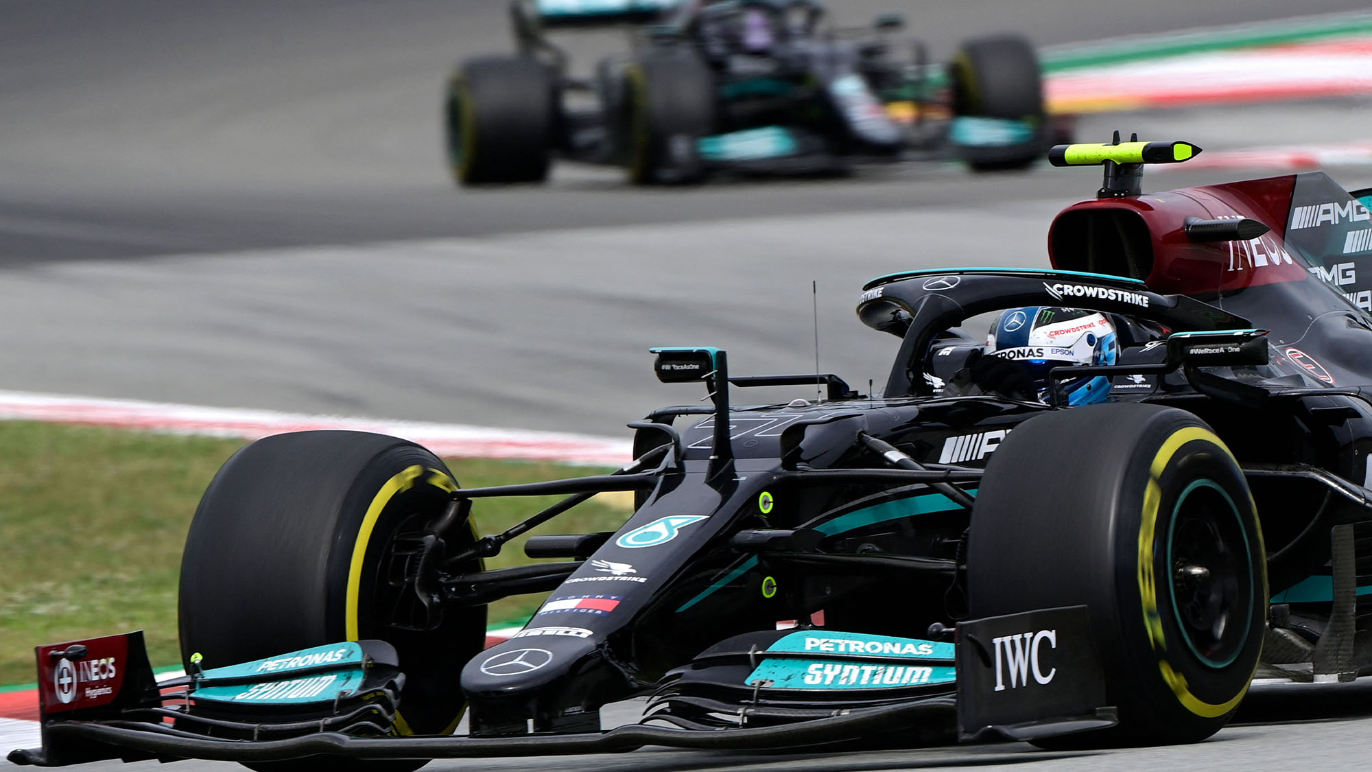 Mercedes' Finnish driver Valtteri Bottas drives ahead of Mercedes' British driver Lewis Hamilton during the Spanish Formula One Grand Prix race at the Circuit de Catalunya on May 9, 2021 in Montmelo on the outskirts of Barcelona. (Photo by JAVIER SORIANO / AFP) (Photo by JAVIER SORIANO/AFP via Getty Images)