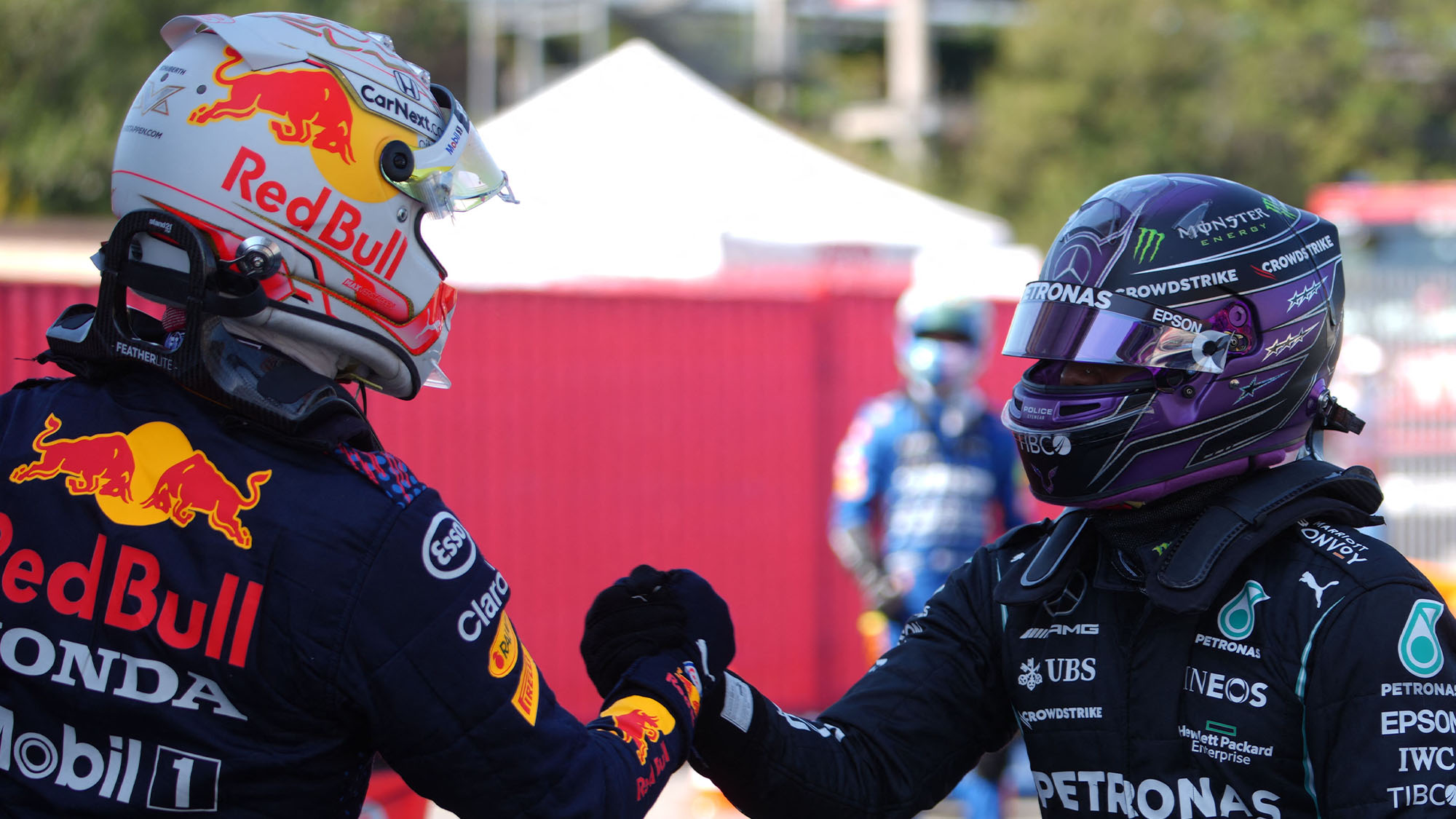 Mercedes' British driver Lewis Hamilton (R) shakes hands with Red Bull's Dutch driver Max Verstappen after the qualifying session at the Circuit de Catalunya on May 8, 2021 in Montmelo on the outskirts of Barcelona ahead of the Spanish Formula One Grand Prix. (Photo by Emilio Morenatti / POOL / AFP) (Photo by EMILIO MORENATTI/POOL/AFP via Getty Images)