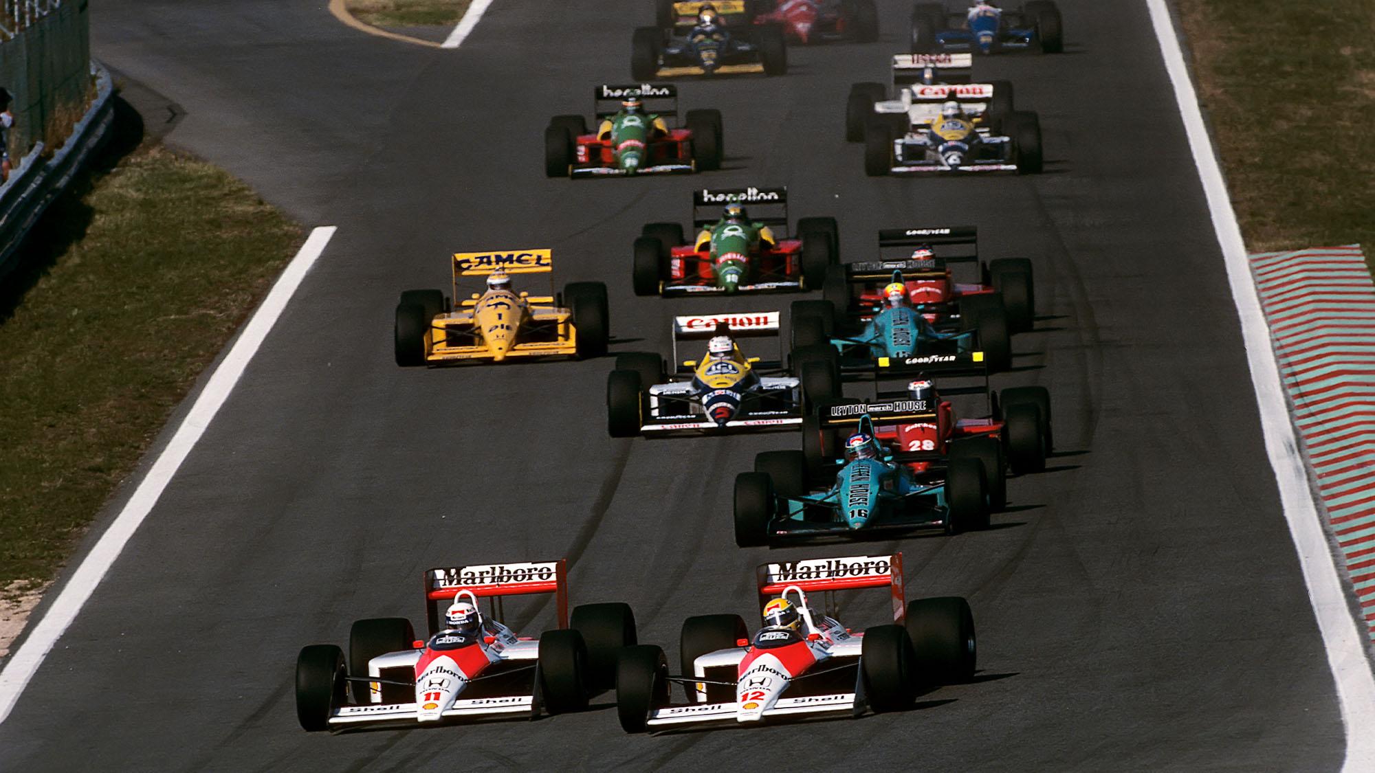 Ayrton Senna, Alain Prost, McLaren-Honda MP4/4, Grand Prix of Portugal, Estoril, 25 September 1988. (Photo by Paul-Henri Cahier/Getty Images)