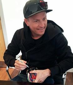 Kimi Raikkonen signing a model helmet