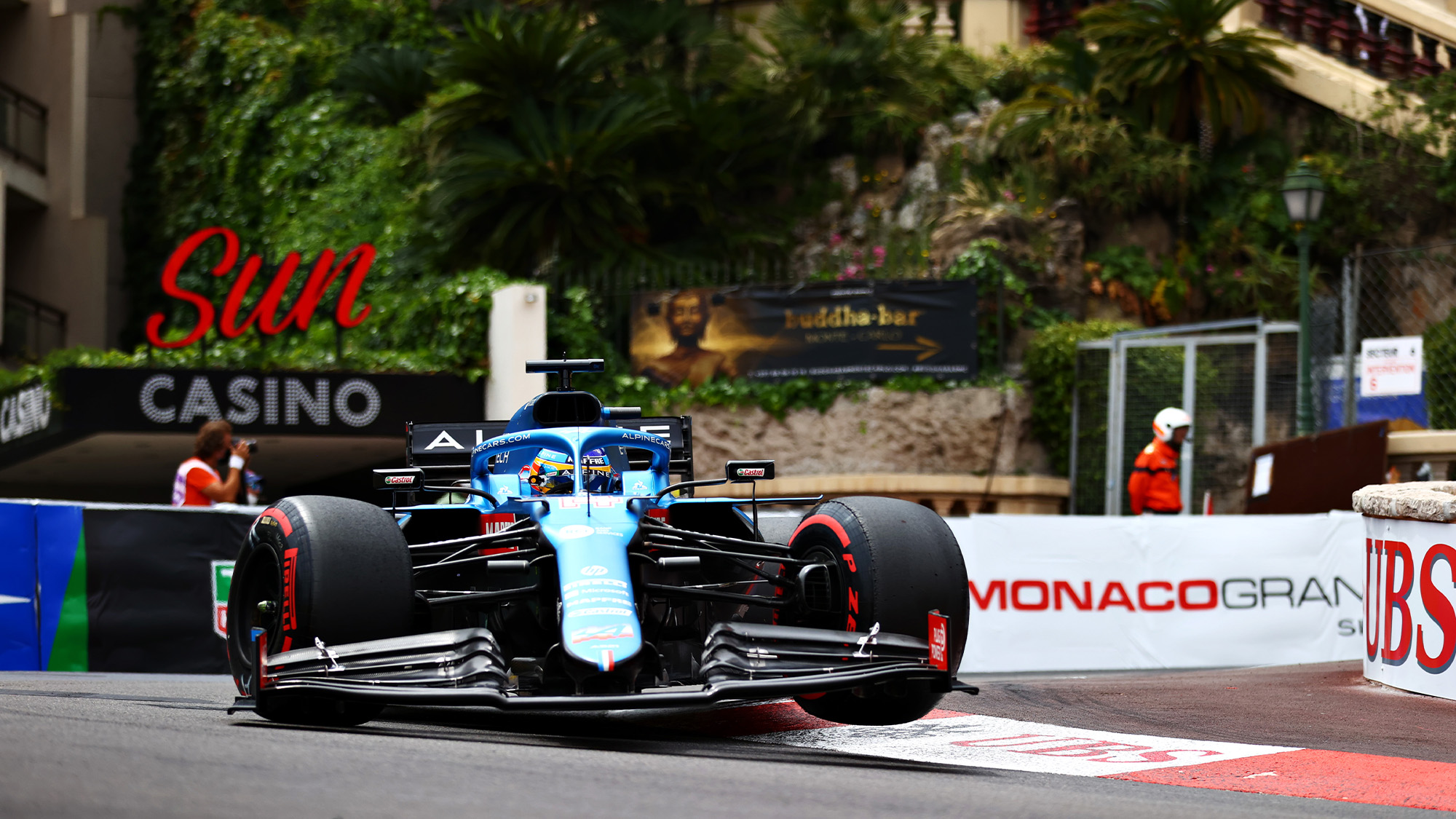 fernando alonso over the kerb of the hairpin in qualifying for the 2021 f1 monaco grand prix