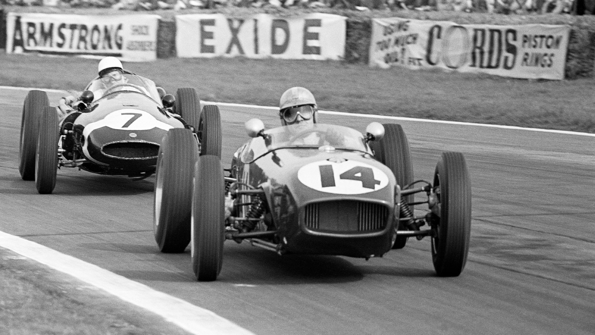 Innes Ireland leads Stirling Moss in the 1960 Goodwood Easter Monday meeting
