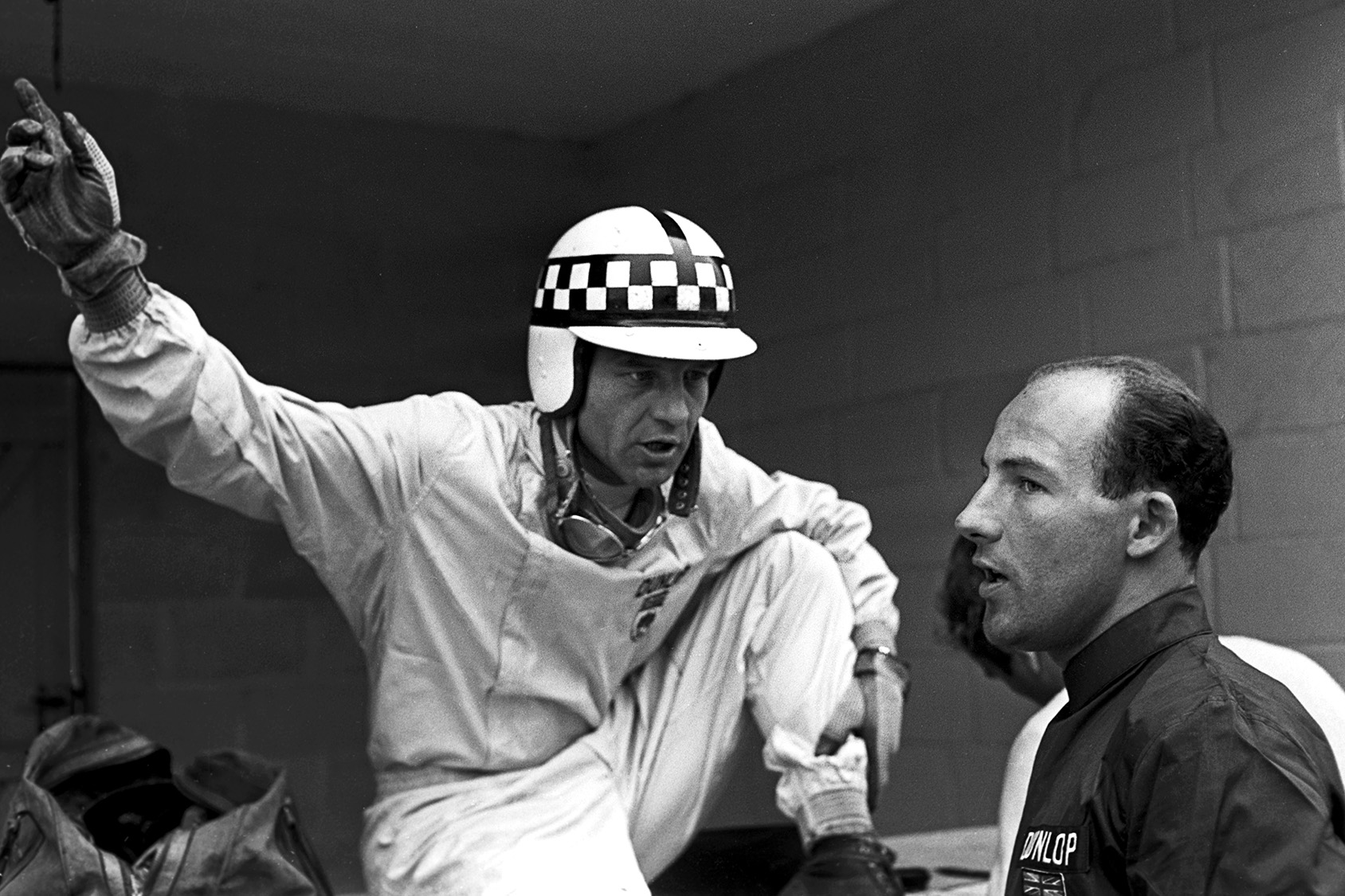 Innes Ireland and Stirling Moss at the 1960 Belgian Grand Prix