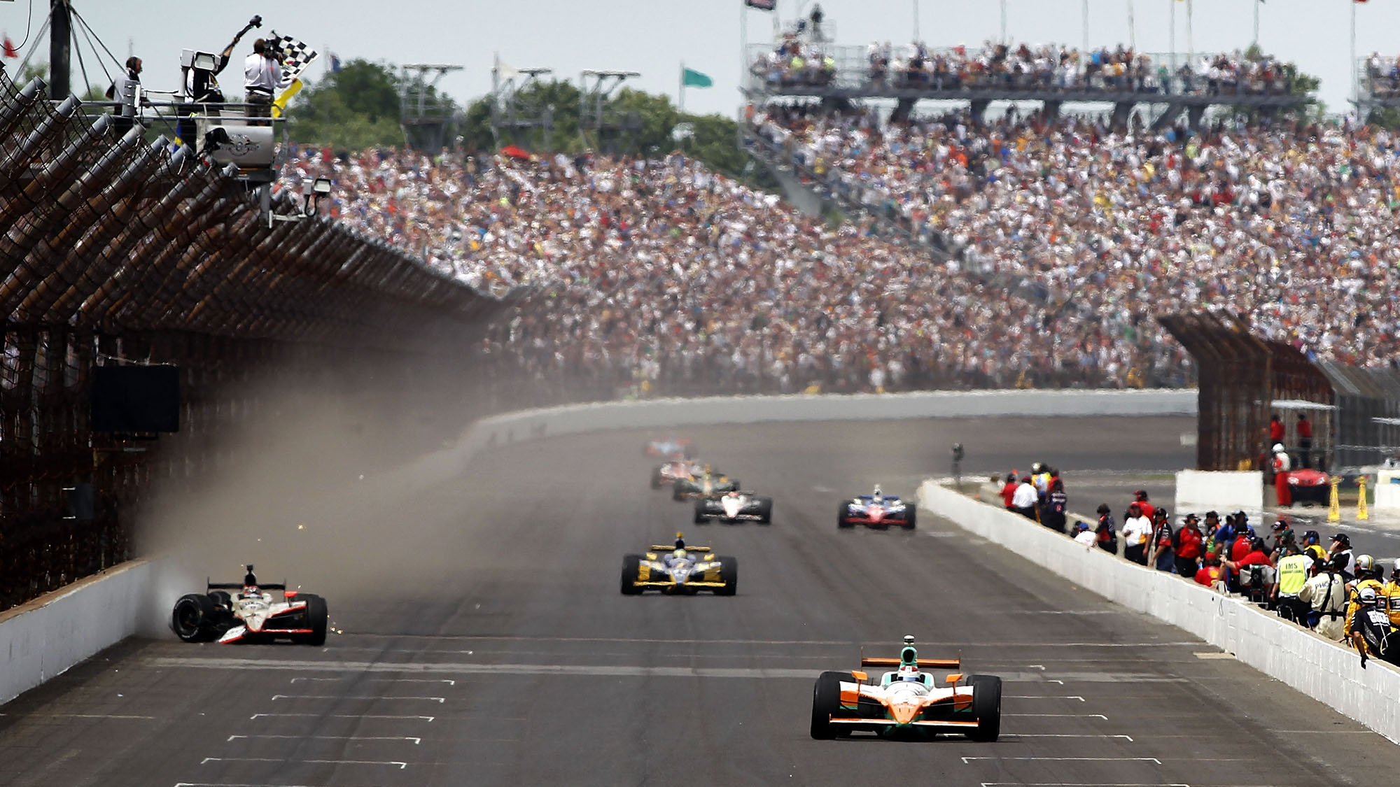 INDIANAPOLIS - MAY 29: Charlie Kimball (R), driver of the #83 Novo Nordisk Chip Ganassi Racing Dallara Honda, crosses the finish line during the IZOD IndyCar Series Indianapolis 500 Mile Race, as JR Hildebrand (left), driver of the #4 National Guard Panther Racing, finishes second after hitting the wall at Indianapolis Motor Speedway on May 29, 2011 in Indianapolis, Indiana. (Photo by Todd Warshaw/Getty Images)