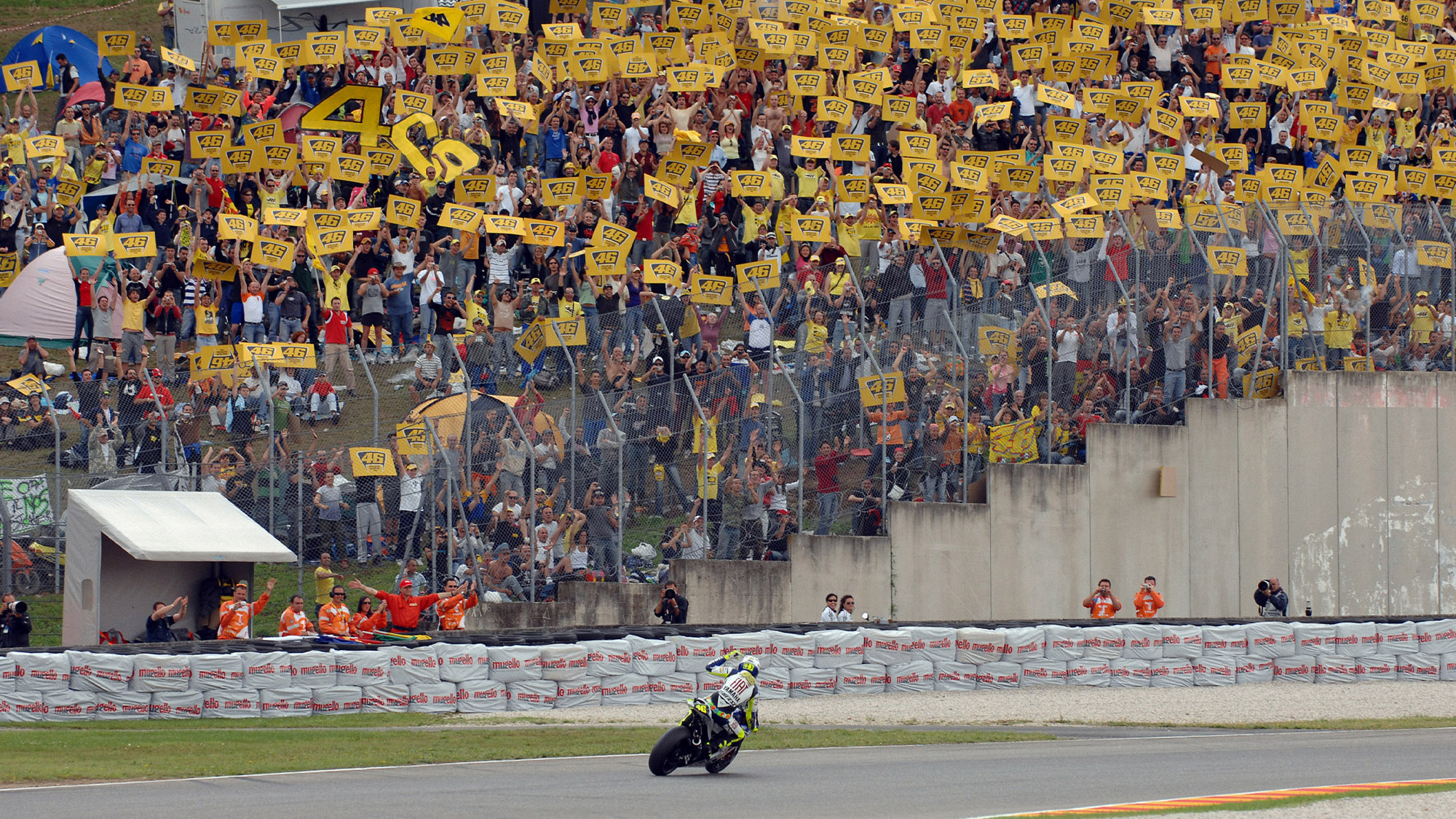 Valentino Rossi celebrates victory in front of a home crowd at the 2007 MotoGP Italian Grand Prix