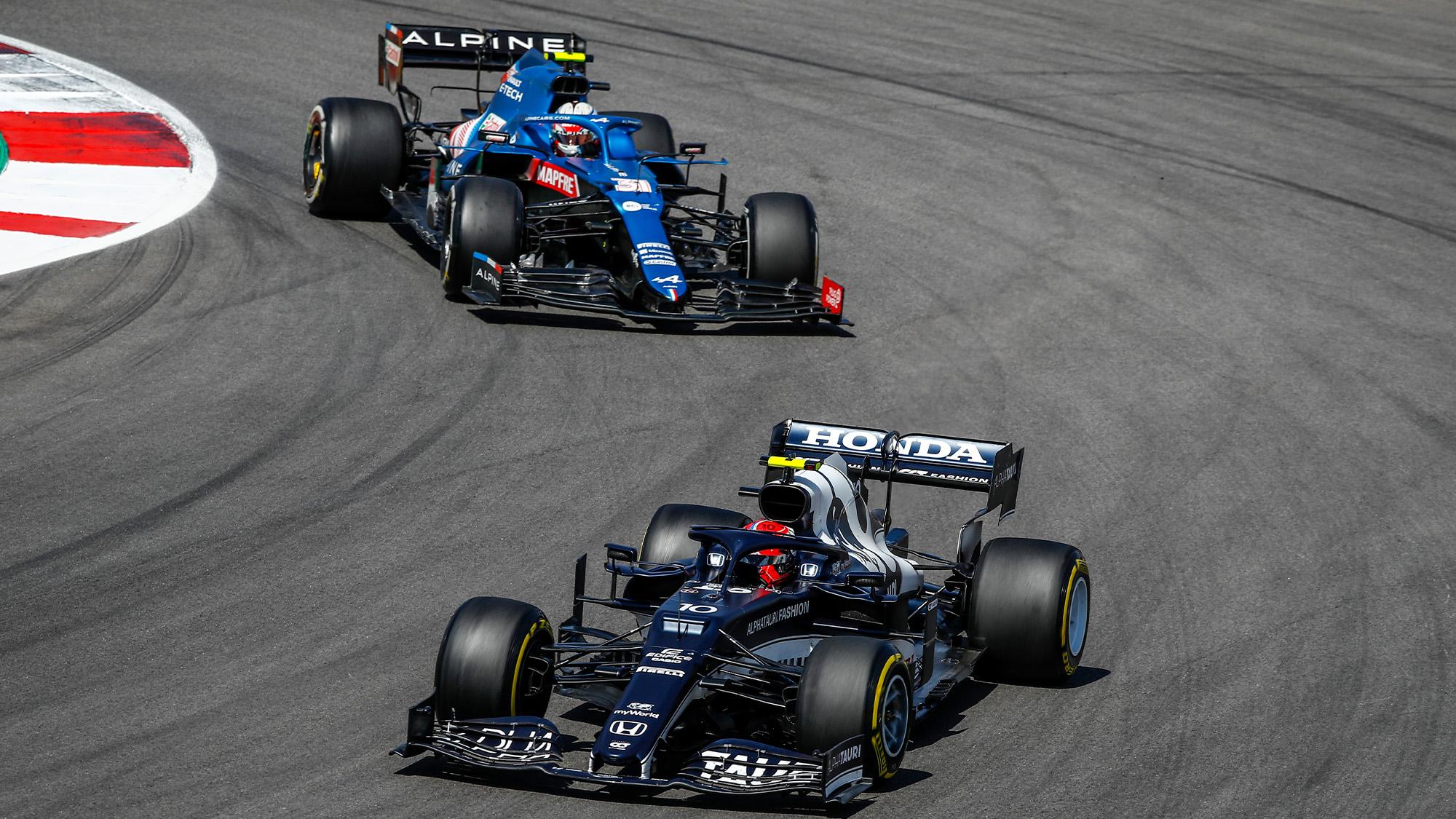 Esteban Ocon and Pierre Gasly on track