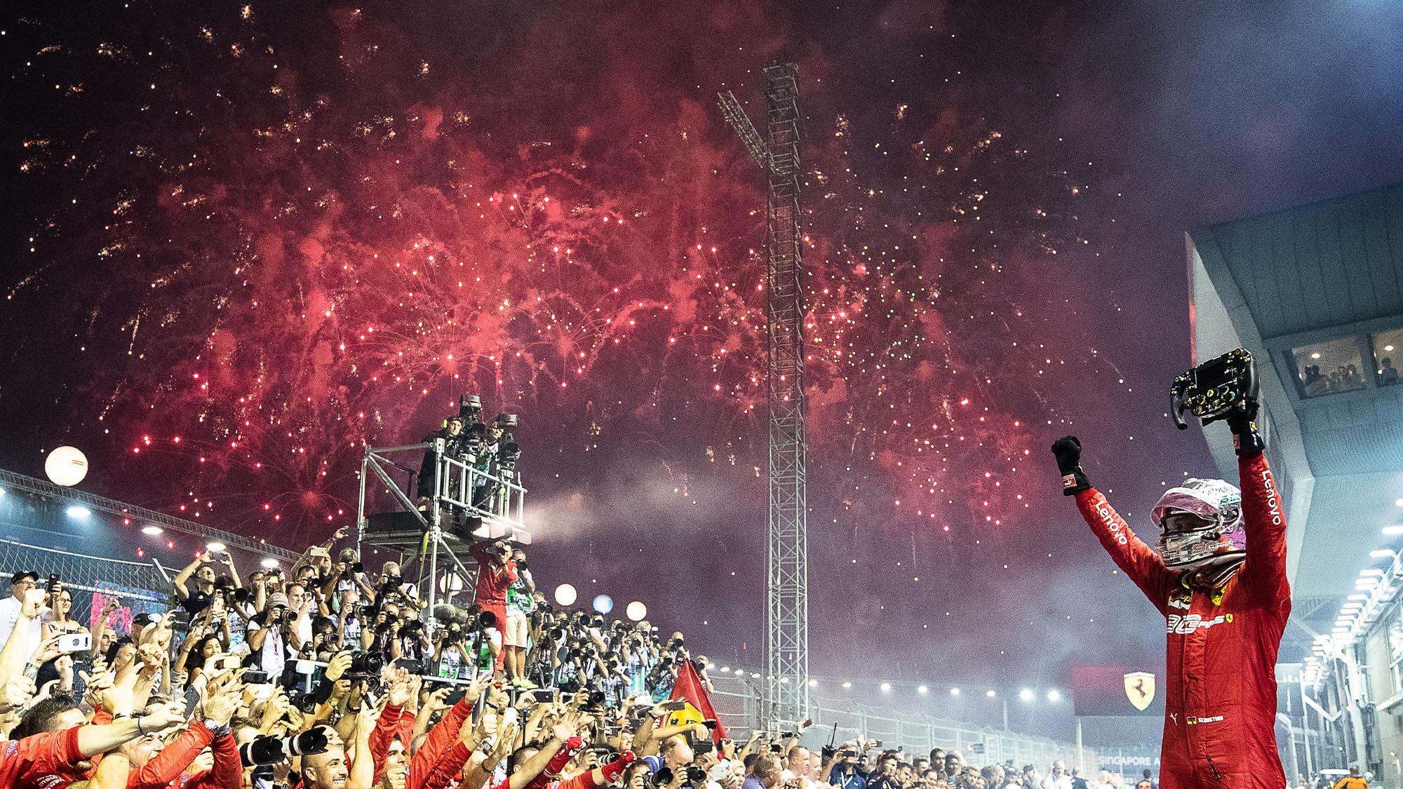 Sebastian Vettel celebrates victory in the 2019 Singapore GP with fireworks