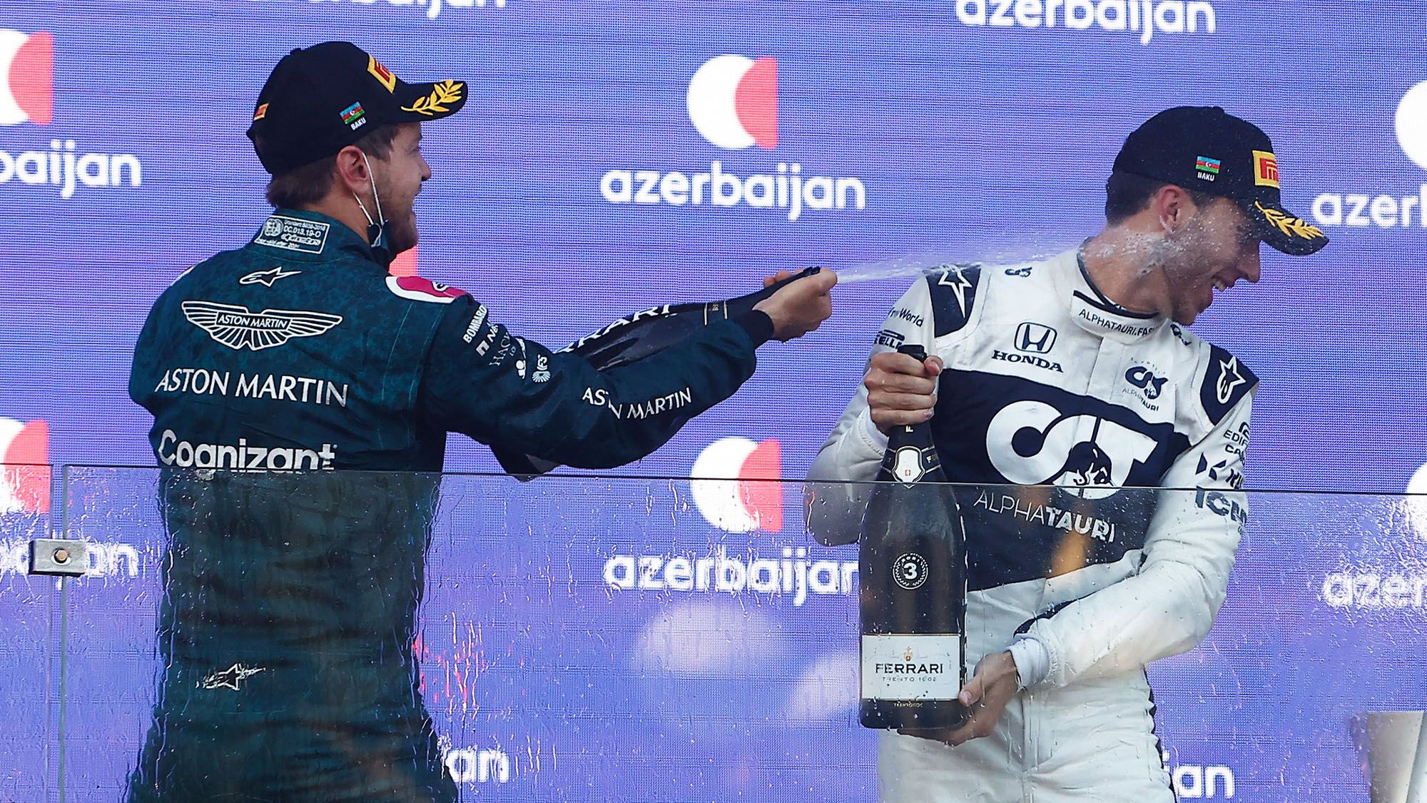 Sebastian Vettel and Pierre Gasly spray champagne after the 2021 Azerbaijan Grand Prix
