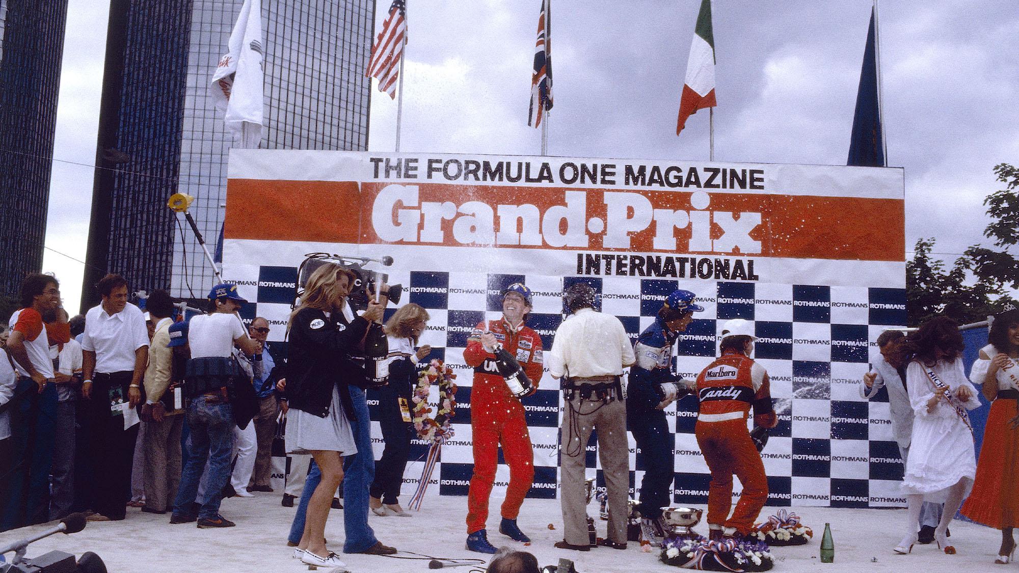 John Watson on the podium after winning the 1982 Detroit GP