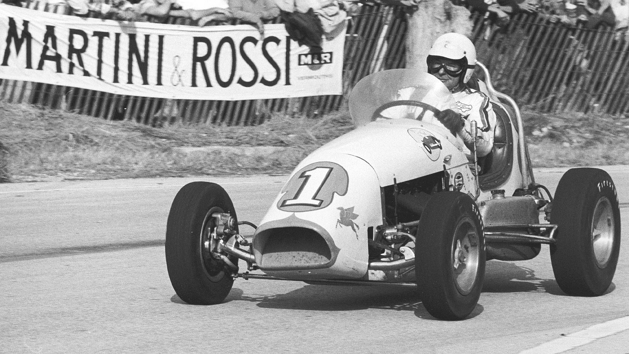 LAKEVILLE, CT — July 25, 1959: Rodger Ward surprised the racing world by driving Ken Brenn's Kurtis Kraft Offenhauser-powered USAC Midget to victory in the USAC Road Racing Championship event at Lime Rock Park using his more nimble car to defeat the more powerful Maseratis, Aston Martins, Cooper Monacos, Ferraris and Jaguars. (Photo by ISC Images & Archives via Getty Images)