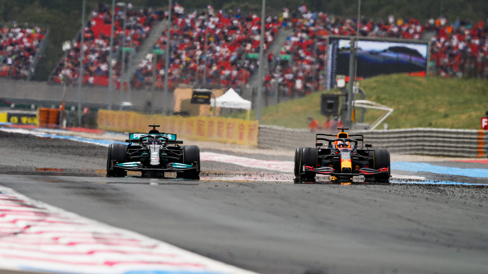Max Verstappen passes Lewis Hamilton in the 2021 French Grand Prix