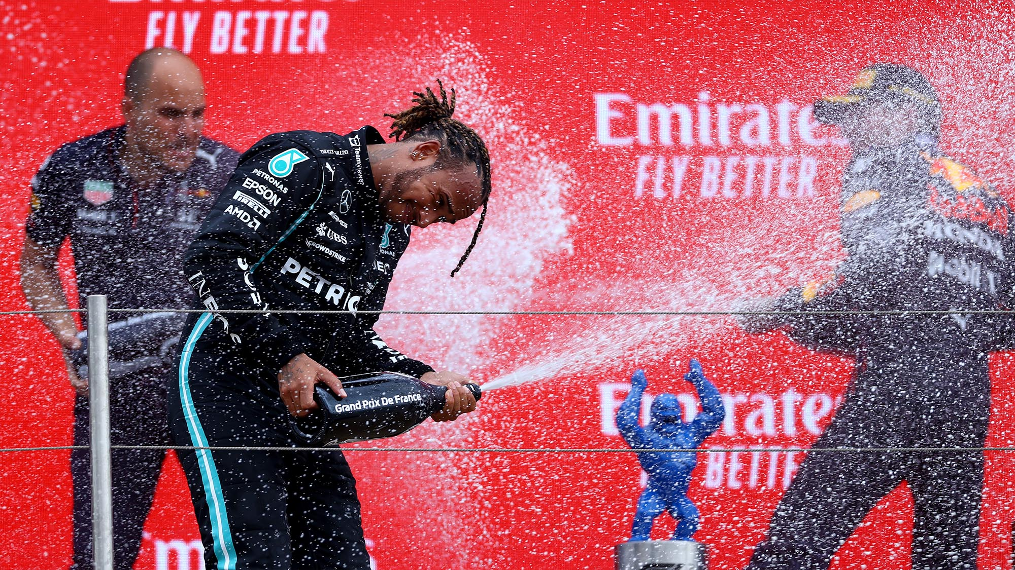 Lewis Hamilton and Max Verstappen spray champ[agne on the podium at the 2021 French Grand Prix