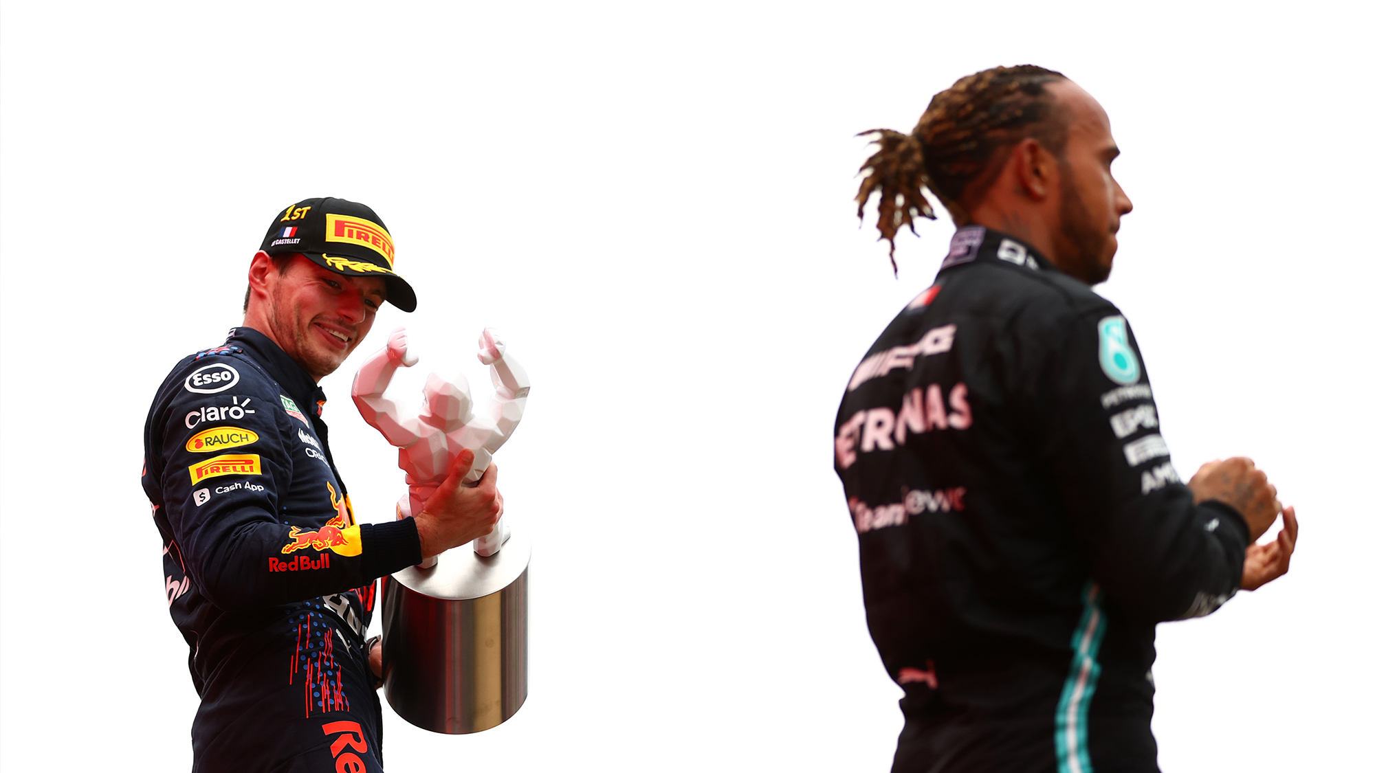 Max Verstappen examines his winning trophy at the 2021 French Grand Prix