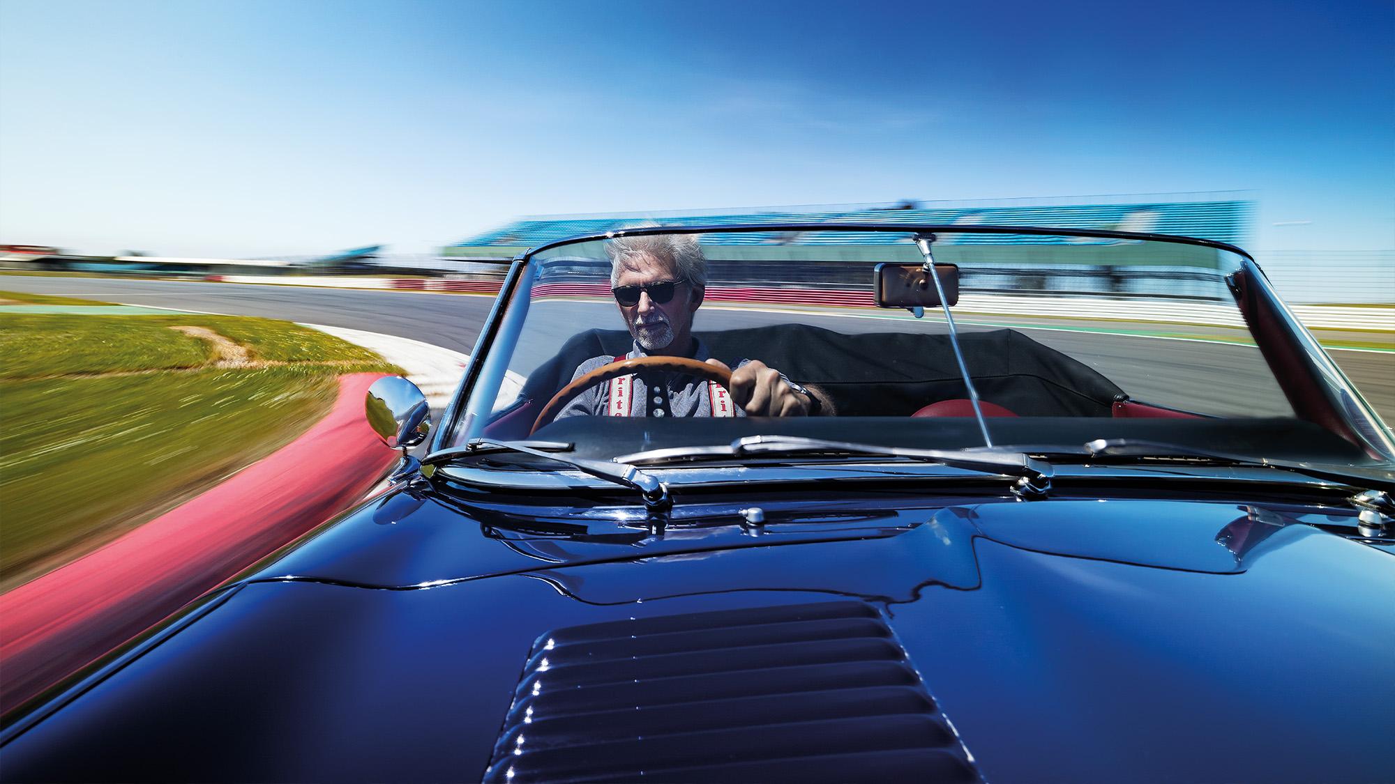Bonnet shot of Damon Hill in Graham Hill race-winning Jaguar E-type