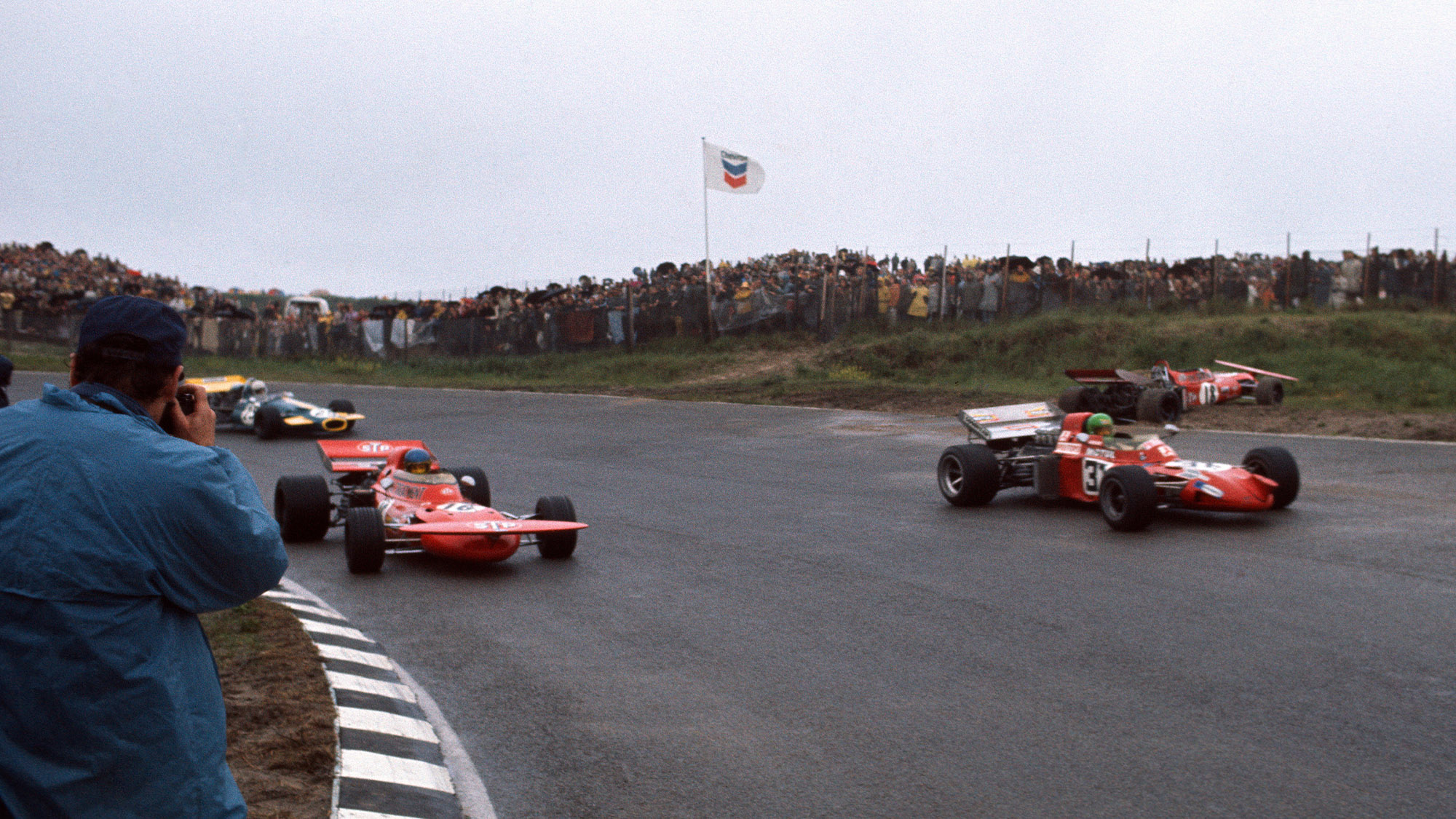 Pescarolo, Peterson and Schenken pass the crashed car of Nanni Galli at the 1971 Dutch GP