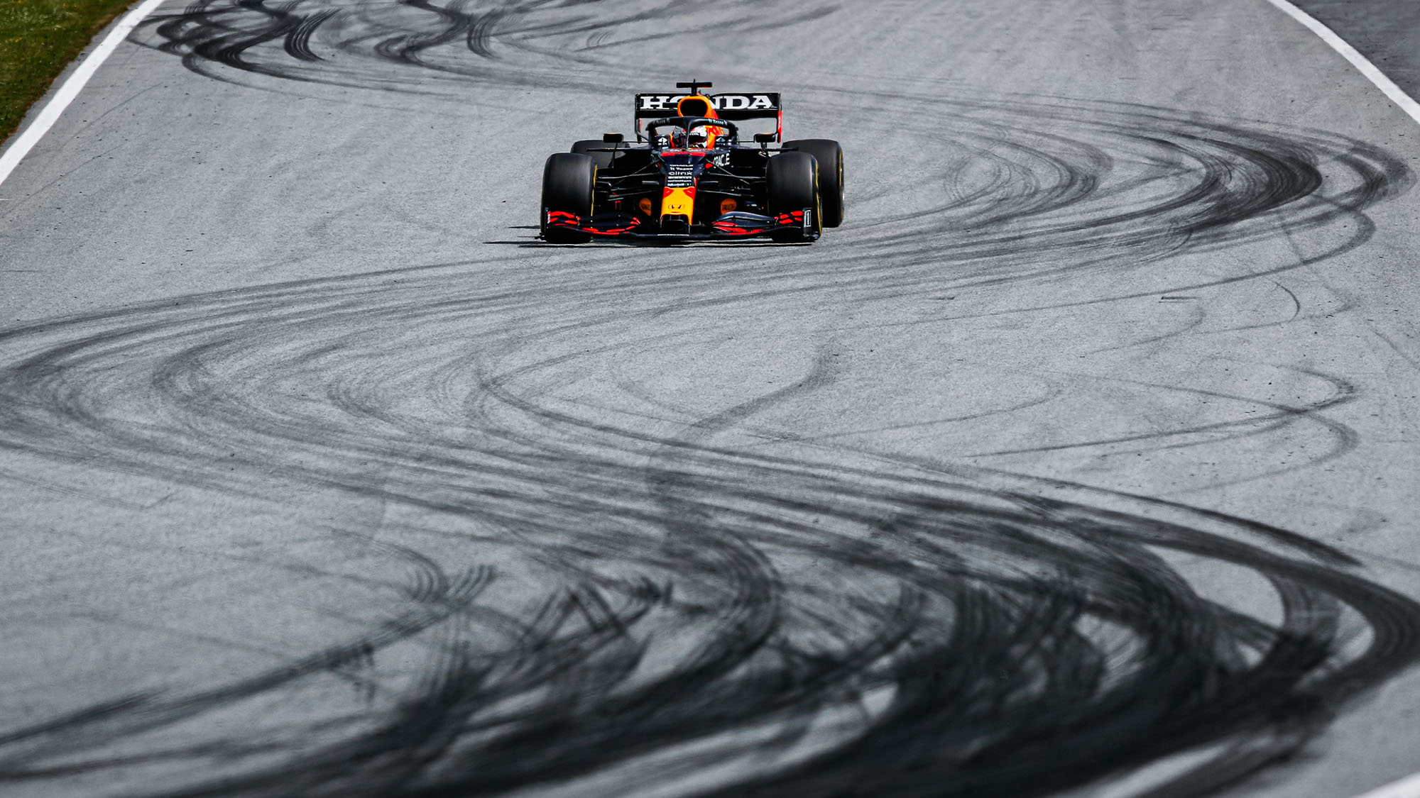 Max Verstappen drives over tyre marks at the 2021 Styrian Grand Prix