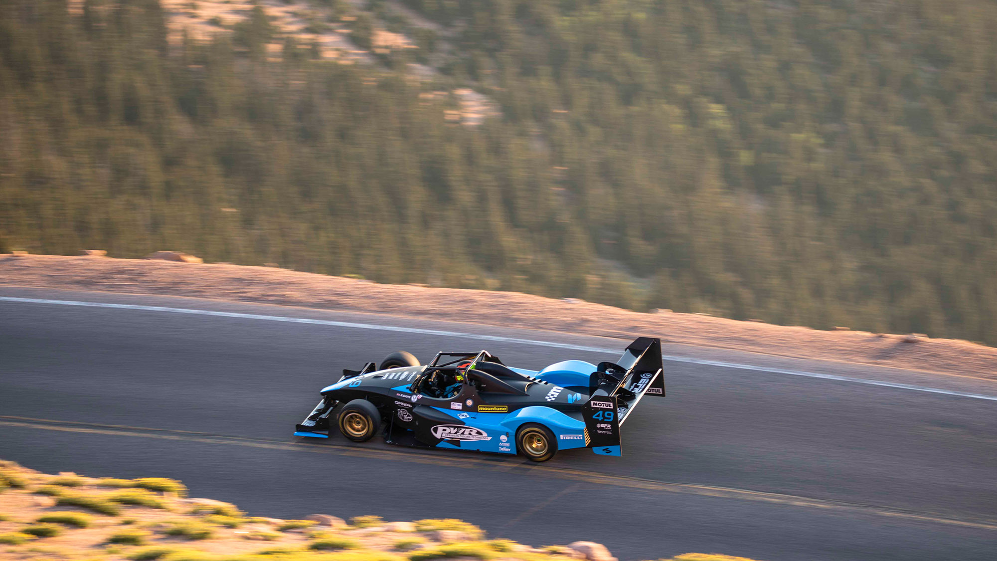 Robin Shute driving up Pike's Peak in his Wolf in 202