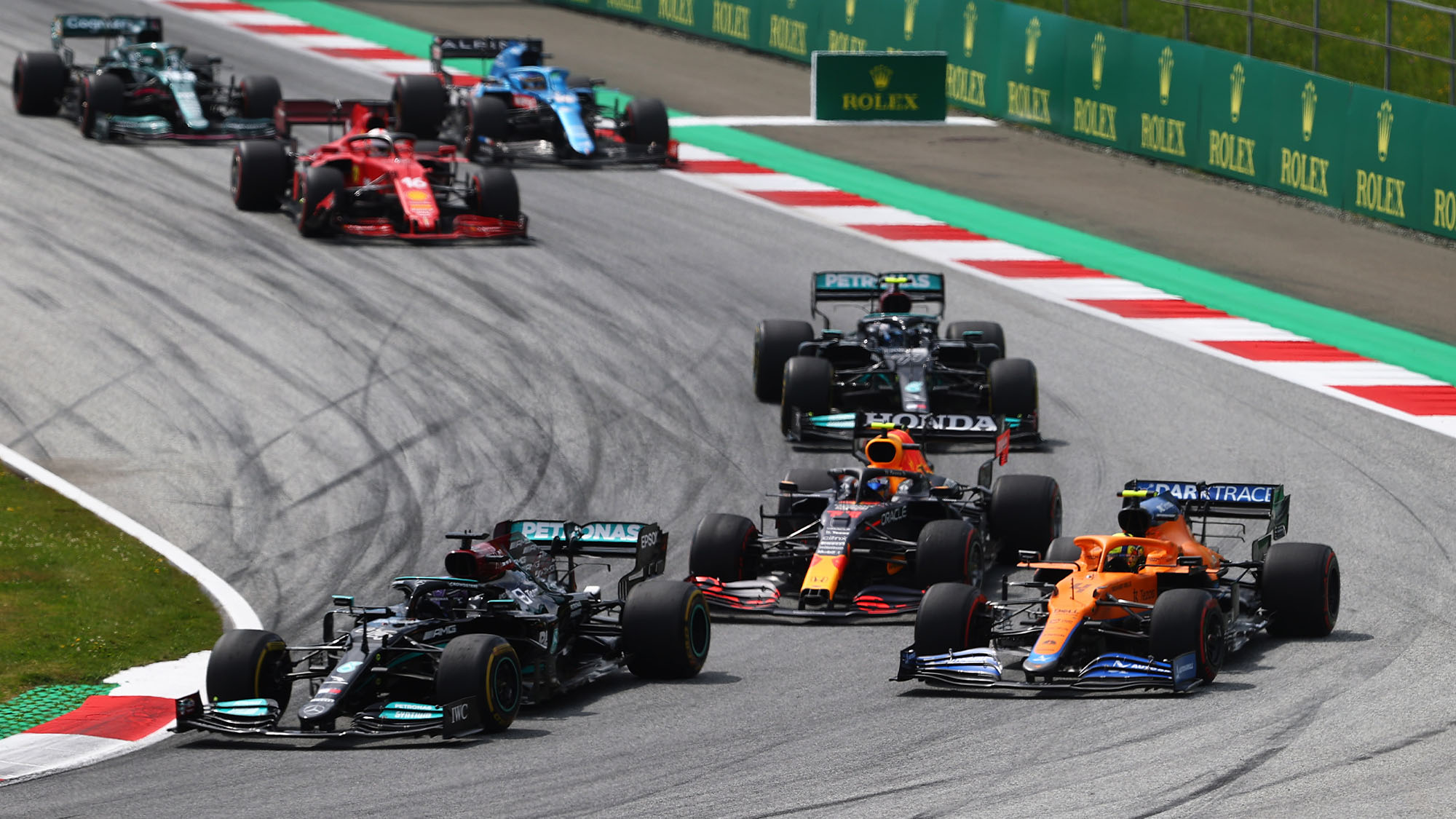 SPIELBERG, AUSTRIA - JUNE 27: Lewis Hamilton of Great Britain driving the (44) Mercedes AMG Petronas F1 Team Mercedes W12 leads Lando Norris of Great Britain driving the (4) McLaren F1 Team MCL35M Mercedes during the F1 Grand Prix of Styria at Red Bull Ring on June 27, 2021 in Spielberg, Austria. (Photo by Clive Rose/Getty Images)
