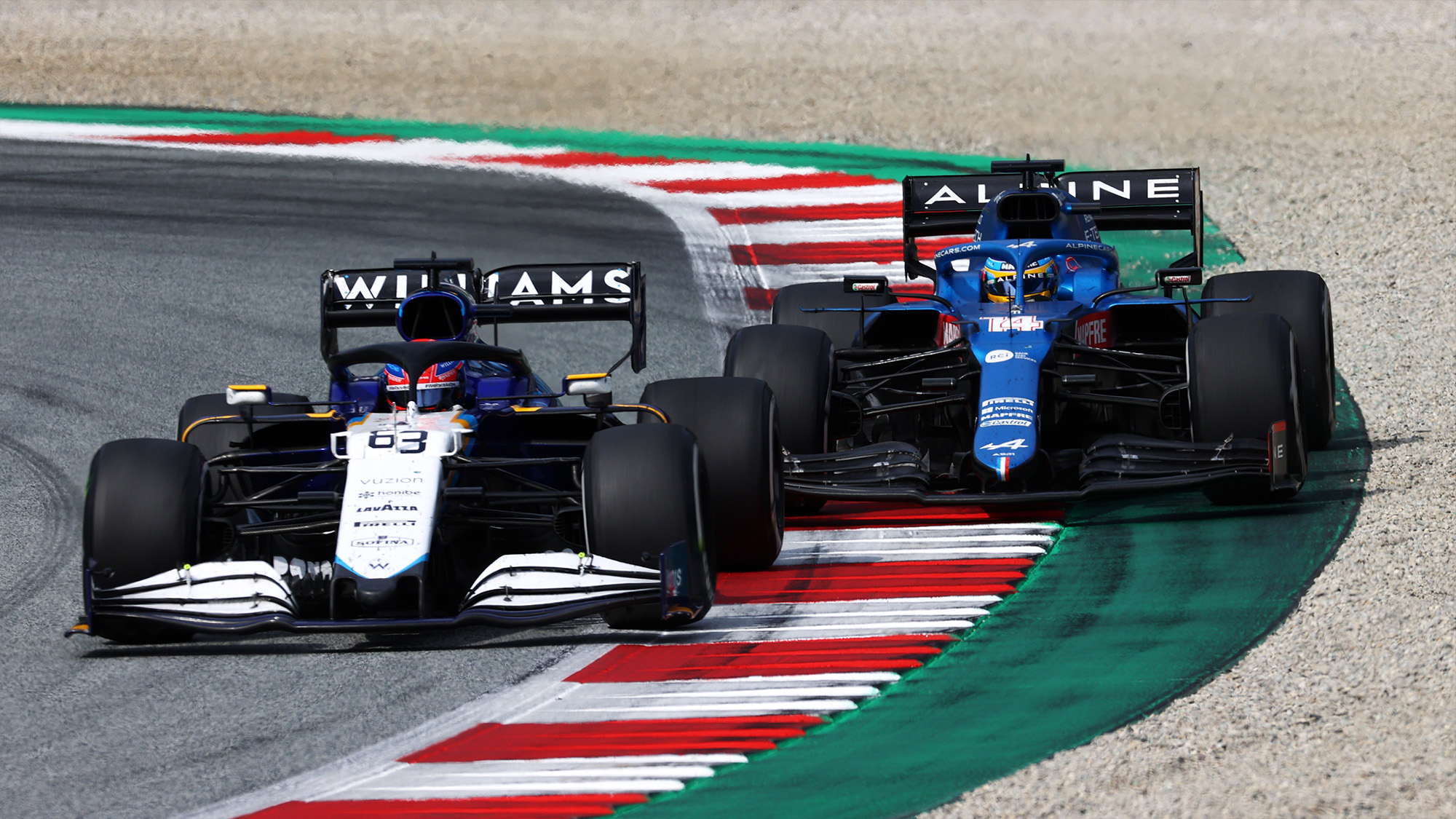 George Russell and Fernando Alonso battle at the 2021 Austrian Grand Prix