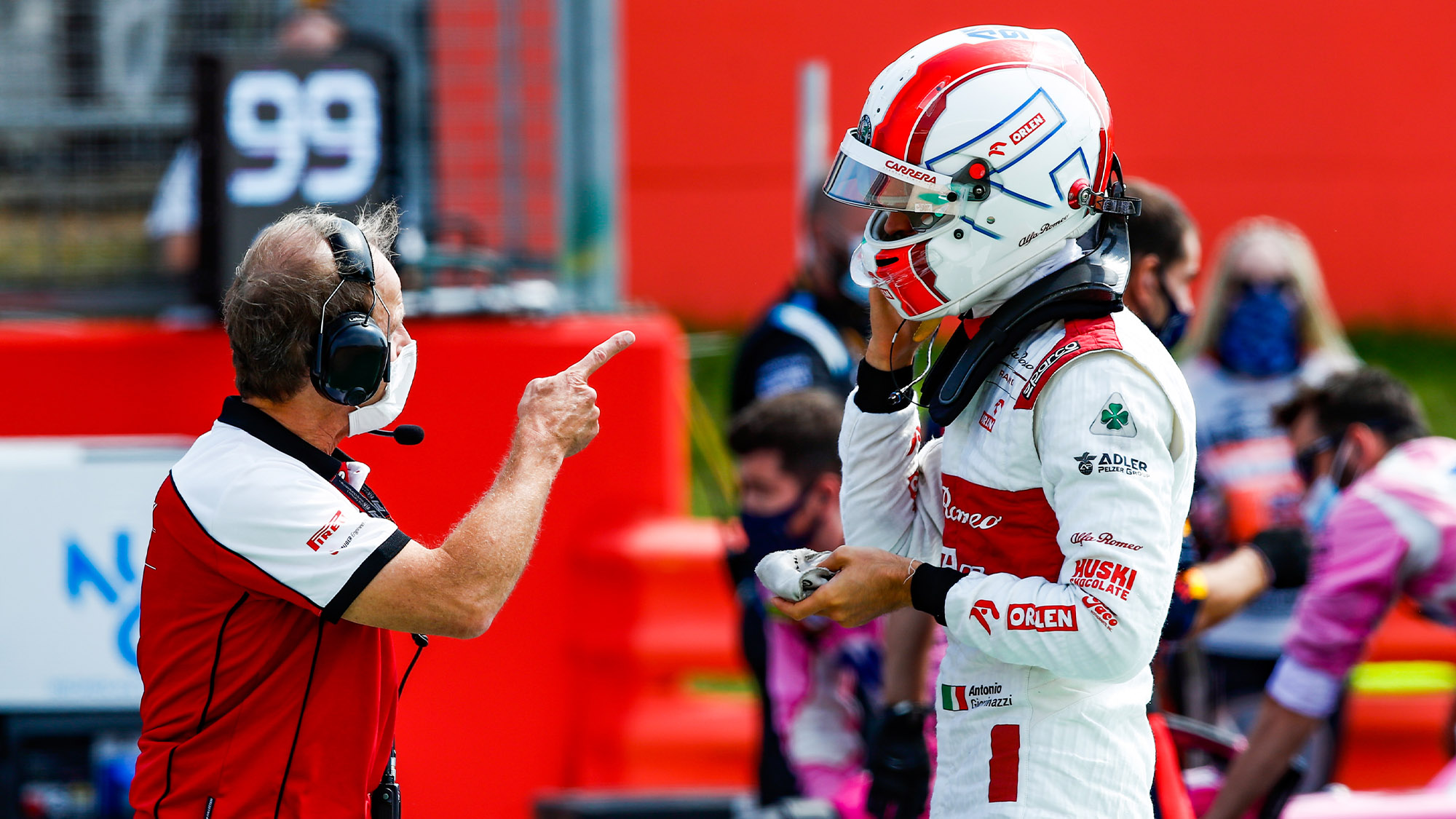 Engineer pointing at Antonio Giovinazzi at Silverstone in 2020