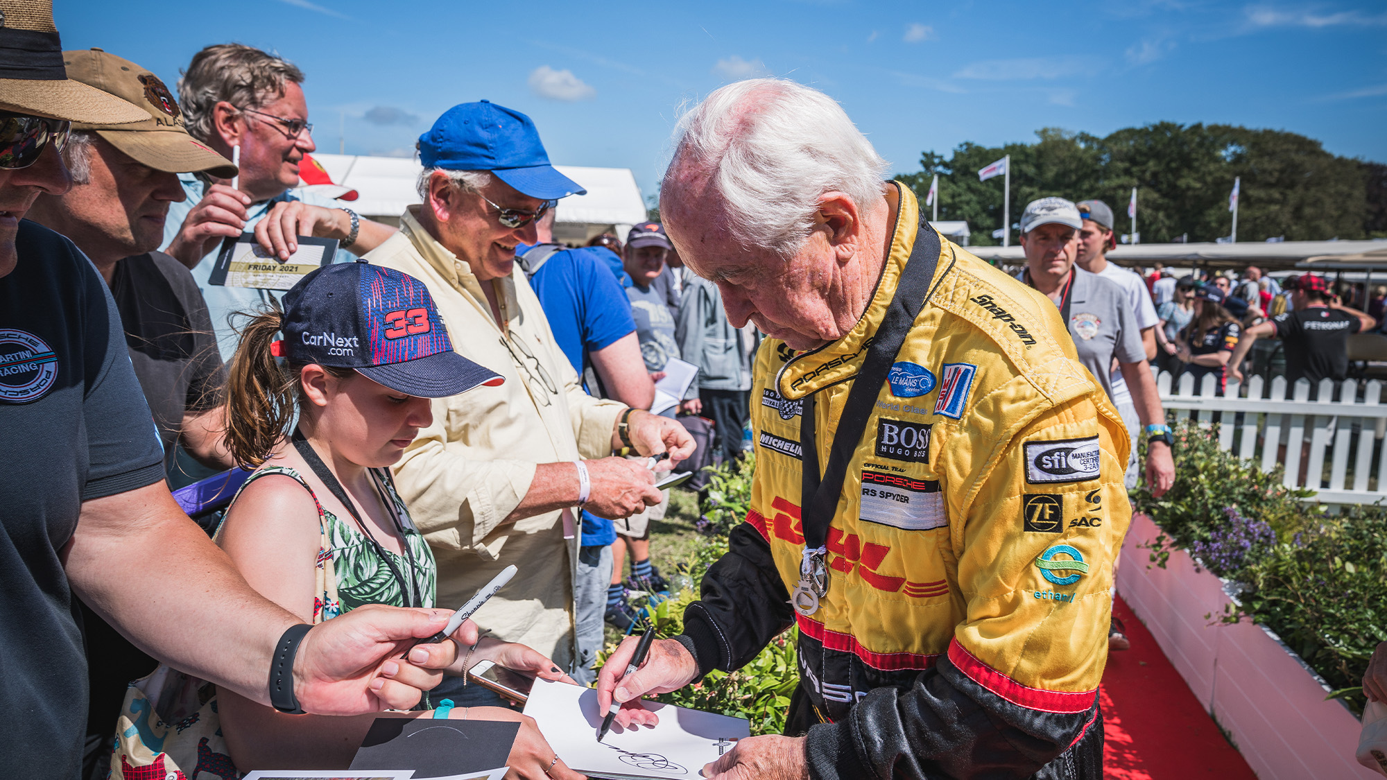 Roger Penske signs autographs at the 2021 Goodwood Festival of Speed