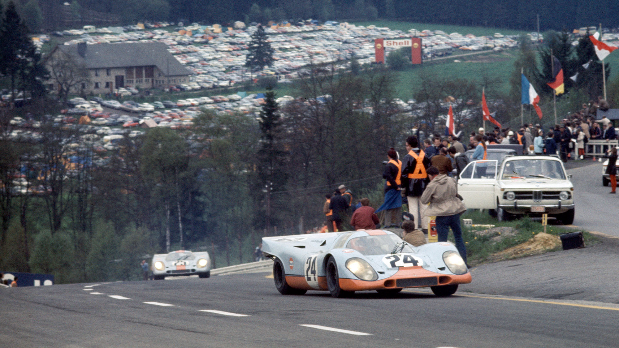 The Porsche 917K driven by Jo Siffert and Brian Redman at the Raidillon corner, followed by the sster car of Pedro Rodriguez and Leo Kinnunen, The Siffert/Redman car will win, Spa-Francochamps 1000Km. (Photo by Nigel Snowdon/Klemantaski Collection/Getty Images)