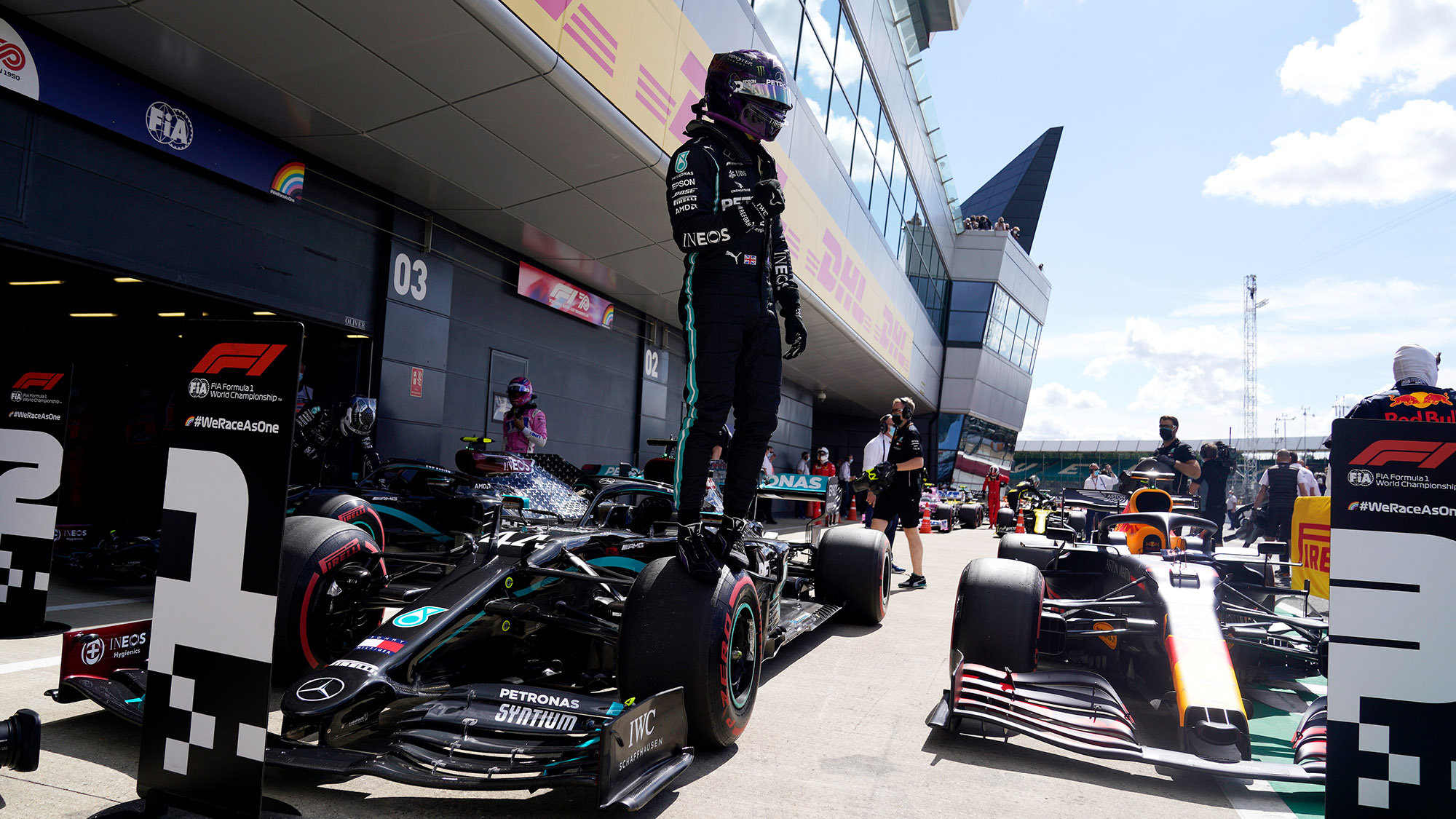 Lewis Hamilton stands on his Mercedes after qualifying on pole for the 2021 British Grand Prix