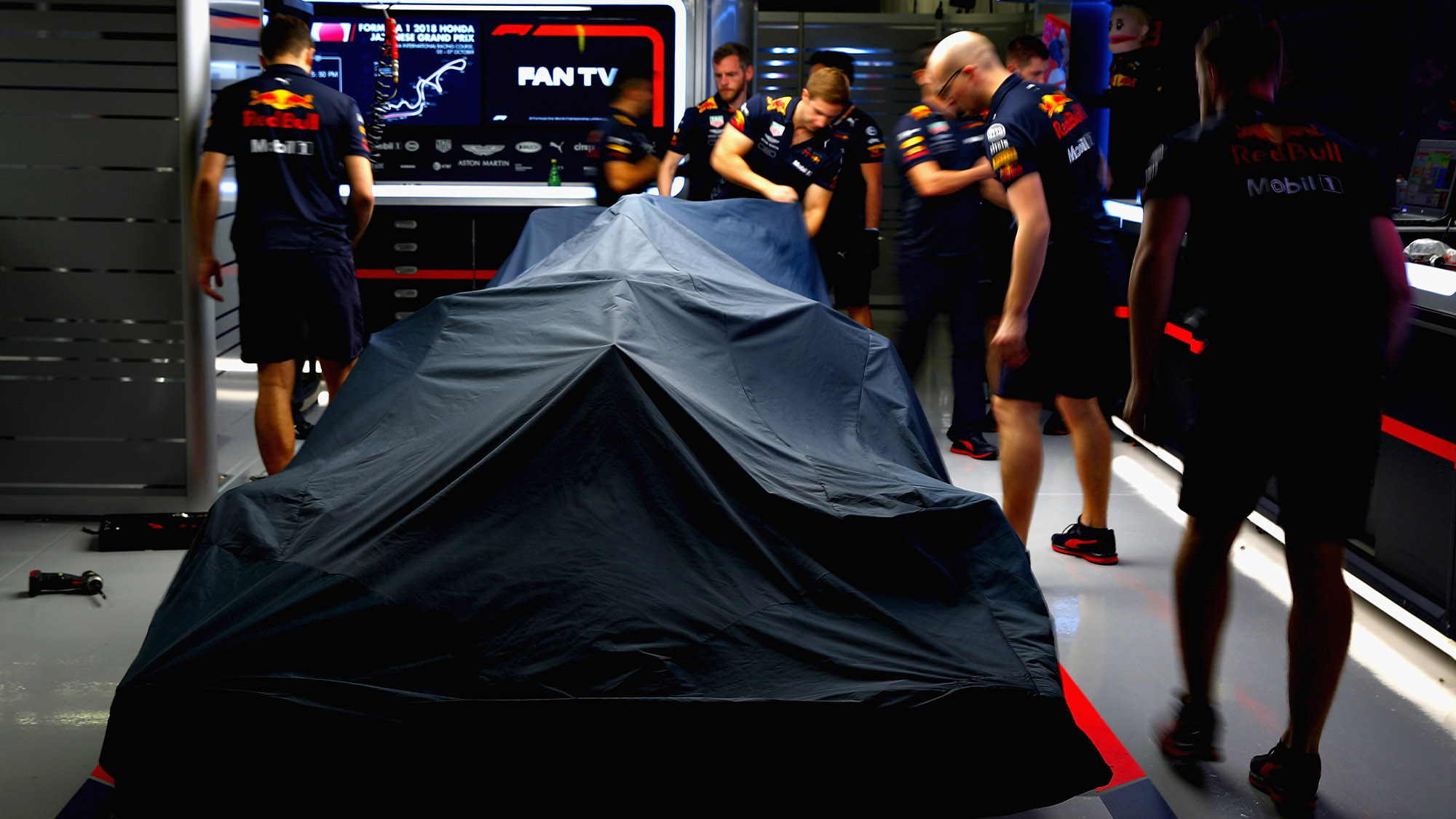 Red Bull in garage with cover