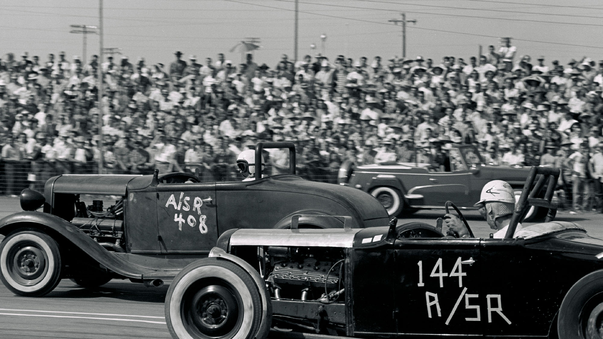 UNITED STATES - SEPTEMBER 03: 1958 NHRA National Drag Races - Oklahoma City. The more modern powered Street Roadster in the far lane pulls a hole shot on the flathead-equipped car in the near lane. (Photo by Bob D'Olivo/The Enthusiast Network via Getty Images/Getty Images)
