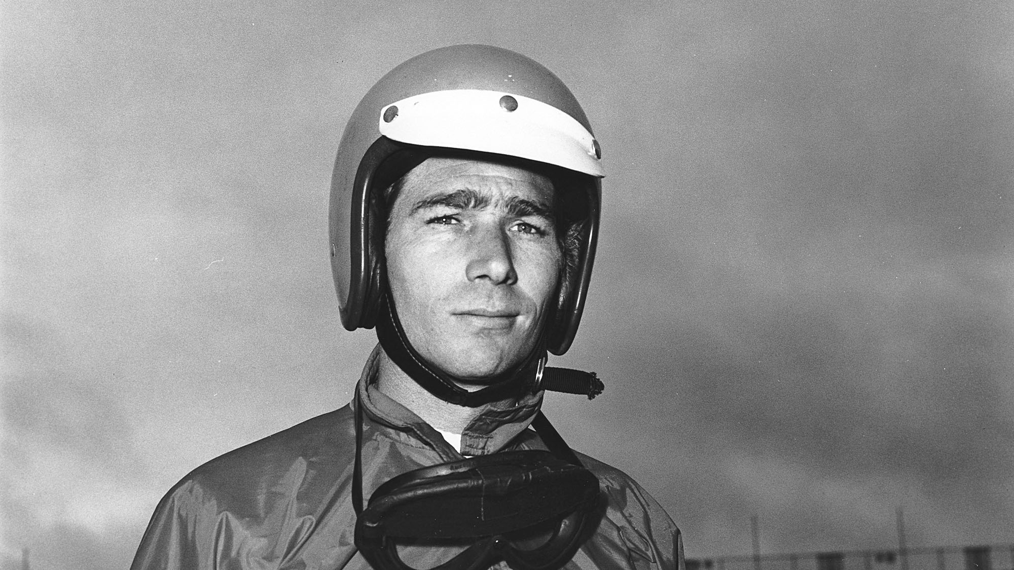 """UNKNOWN — 1960s: Jim Hall of Midland, TX, was not only a top driver and builder of racing cars but was also considered one of racing's greatest """"innovators."""" He co-owned Chaparral Race Cars with good friend and partner, Hap Sharp, and their machines were always considered to be far ahead of their time. Hall was also one of the first builders to experiment with ground effects in racing. After competing for Lotus on the Formula One circuit from 1960 through 1963, Hall and his Chaparral cars went on to score 10 SCCA United States Road Racing Championship victories between 1964 and 1965. One of his biggest wins was in the 12 Hours of Sebring at the Sebring (FL) International Raceway in 1965, defeating the highly touted Ford GT-40s. Turning his attention to Indy Car racing after retiring as a driver, Hall won the Indianapolis 500 at the Indianapolis (IN) Motor Speedway in 1978 with driver Al Unser, and again in 1980 with Johnny Rutherford behind the wheel. (Photo by ISC Images & Archives via Getty Images)"""