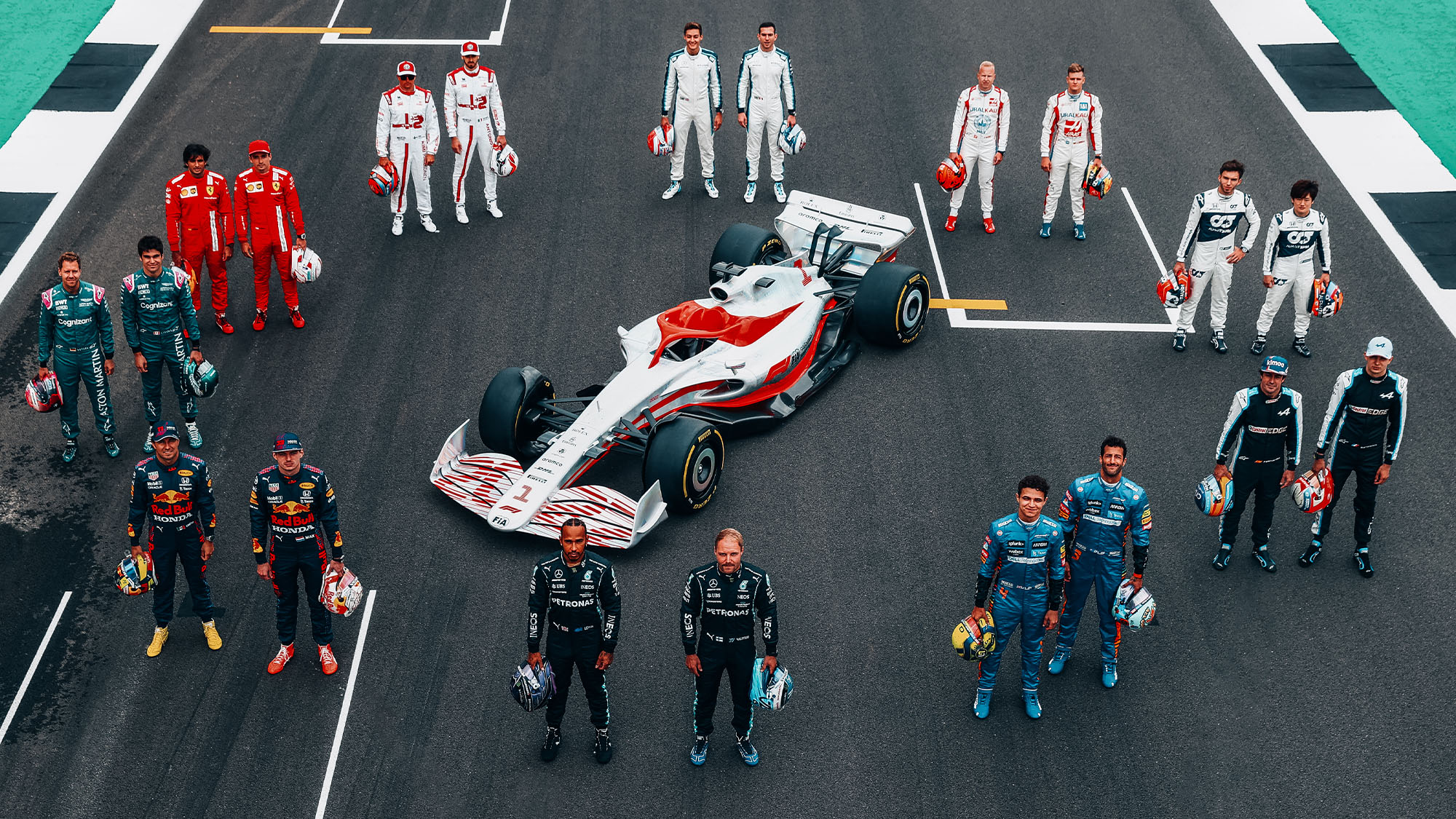 F1 2022 car with F1 drivers from different teams surrounding it