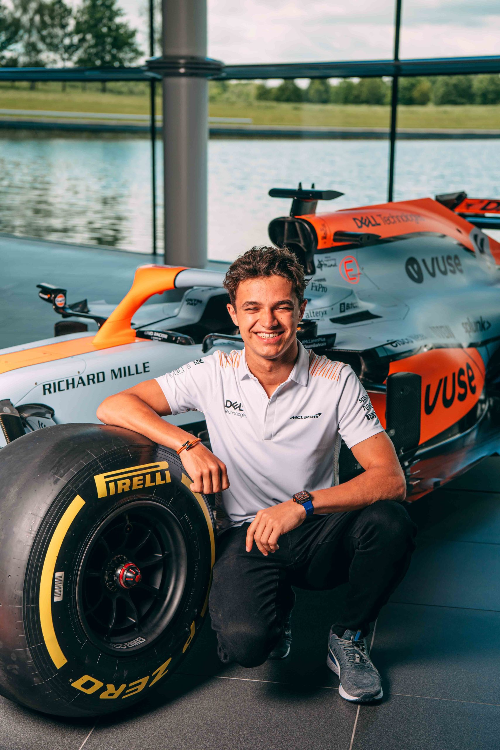 Lando Norris leaning on McLaren