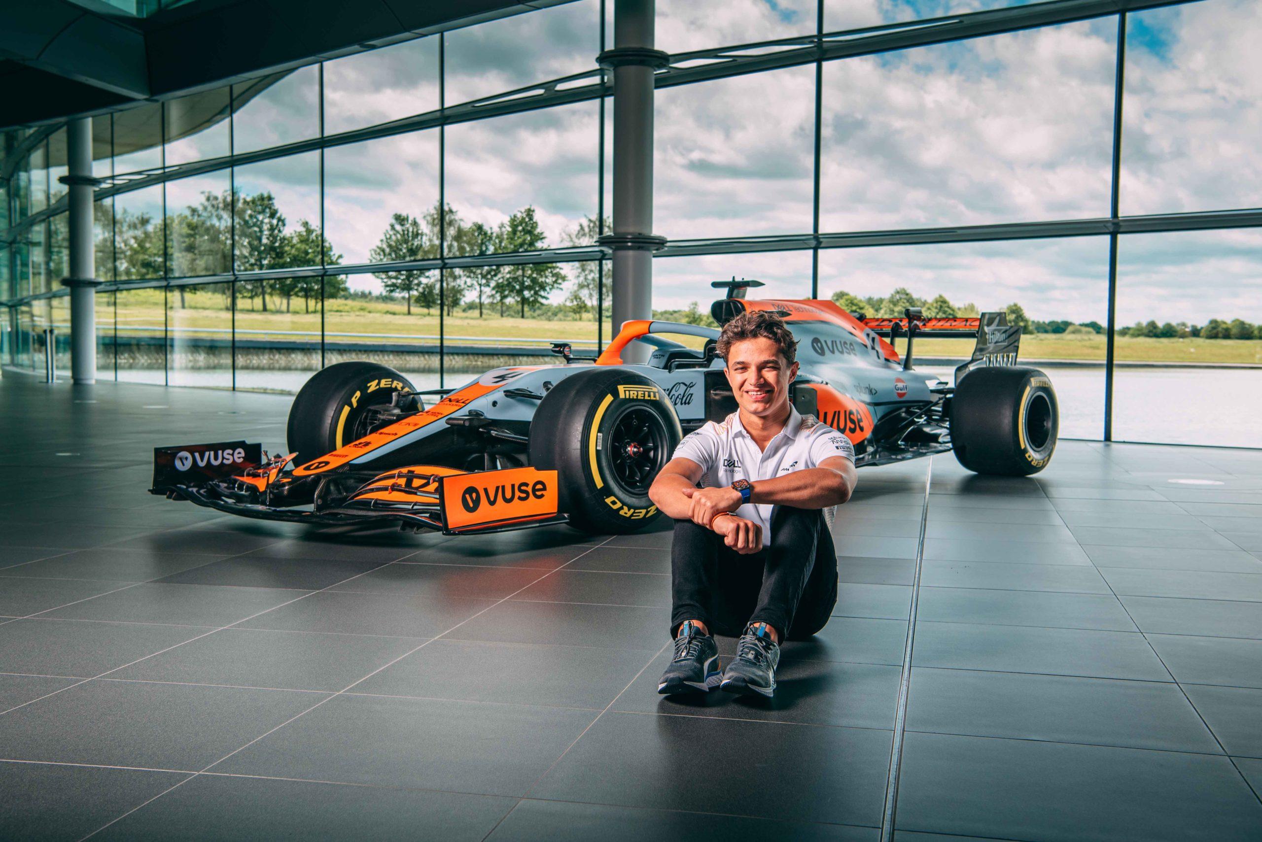 LKando Norris sitting ion front of McLaren