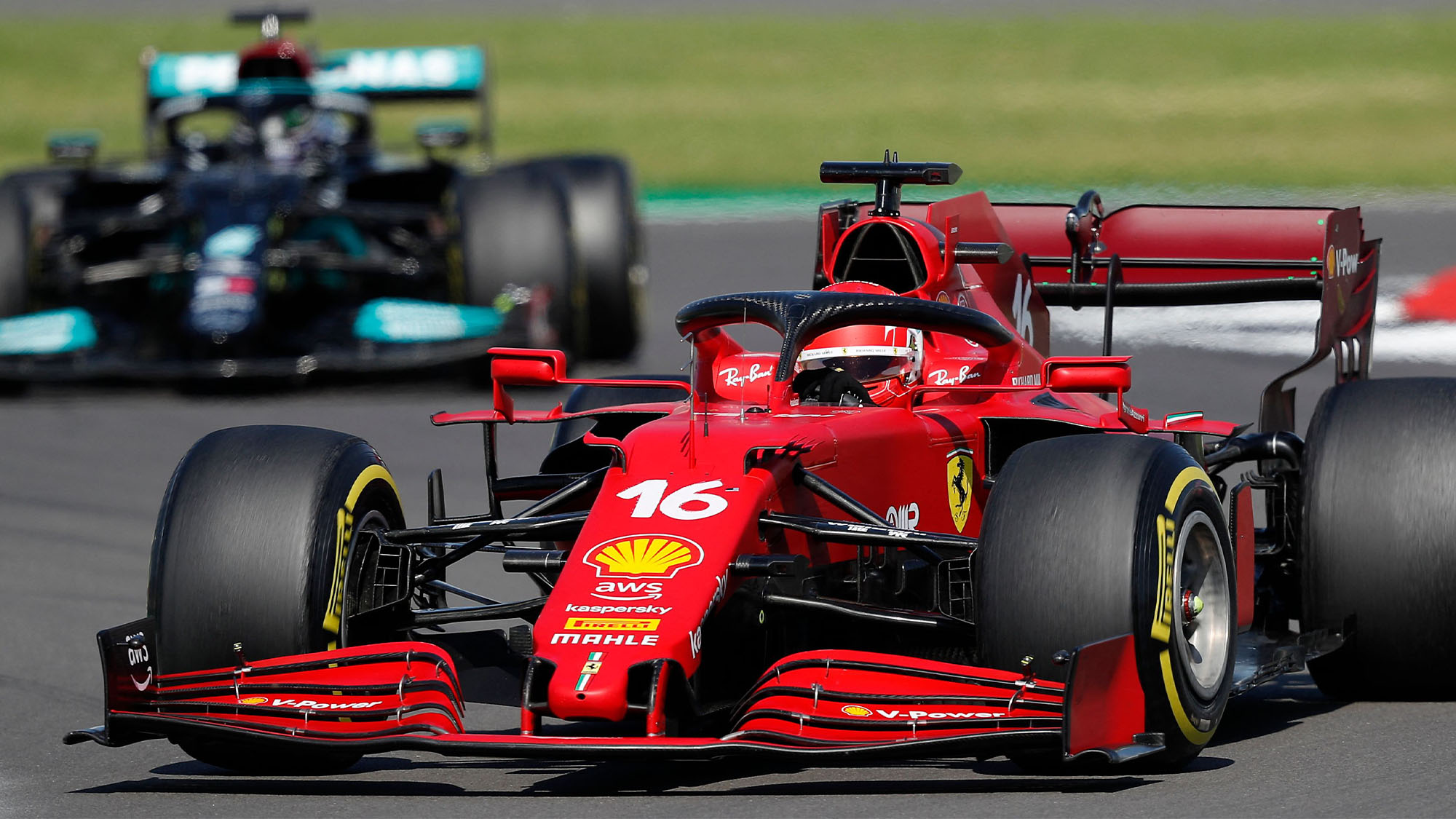 Mercedes' British driver Lewis Hamilton (L) and Ferrari's Monegasque driver Charles Leclerc (R) drive during the Formula One British Grand Prix motor race at Silverstone motor racing circuit in Silverstone, central England on July 18, 2021. (Photo by Adrian DENNIS / AFP) (Photo by ADRIAN DENNIS/AFP via Getty Images)
