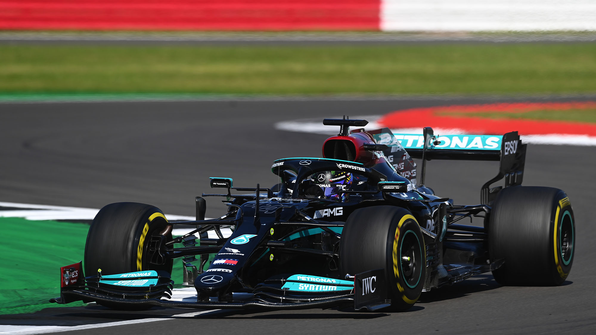 NORTHAMPTON, ENGLAND - JULY 18: Lewis Hamilton of Great Britain driving the (44) Mercedes AMG Petronas F1 Team Mercedes W12 during the F1 Grand Prix of Great Britain at Silverstone on July 18, 2021 in Northampton, England. (Photo by Michael Regan/Getty Images)