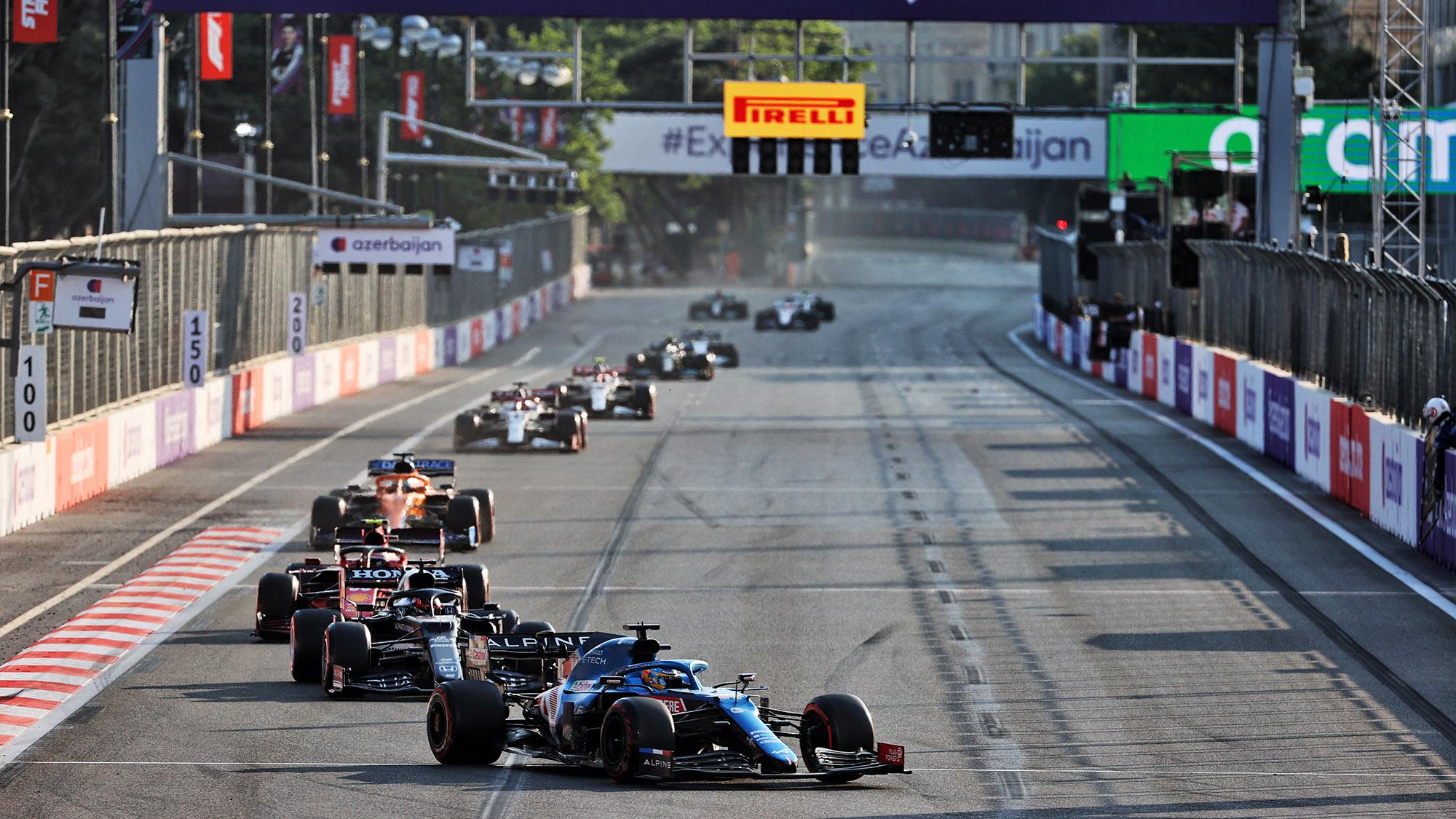 Fernando Alonso leads a line of cars at the 2021 Azerbaijan Grand Prix