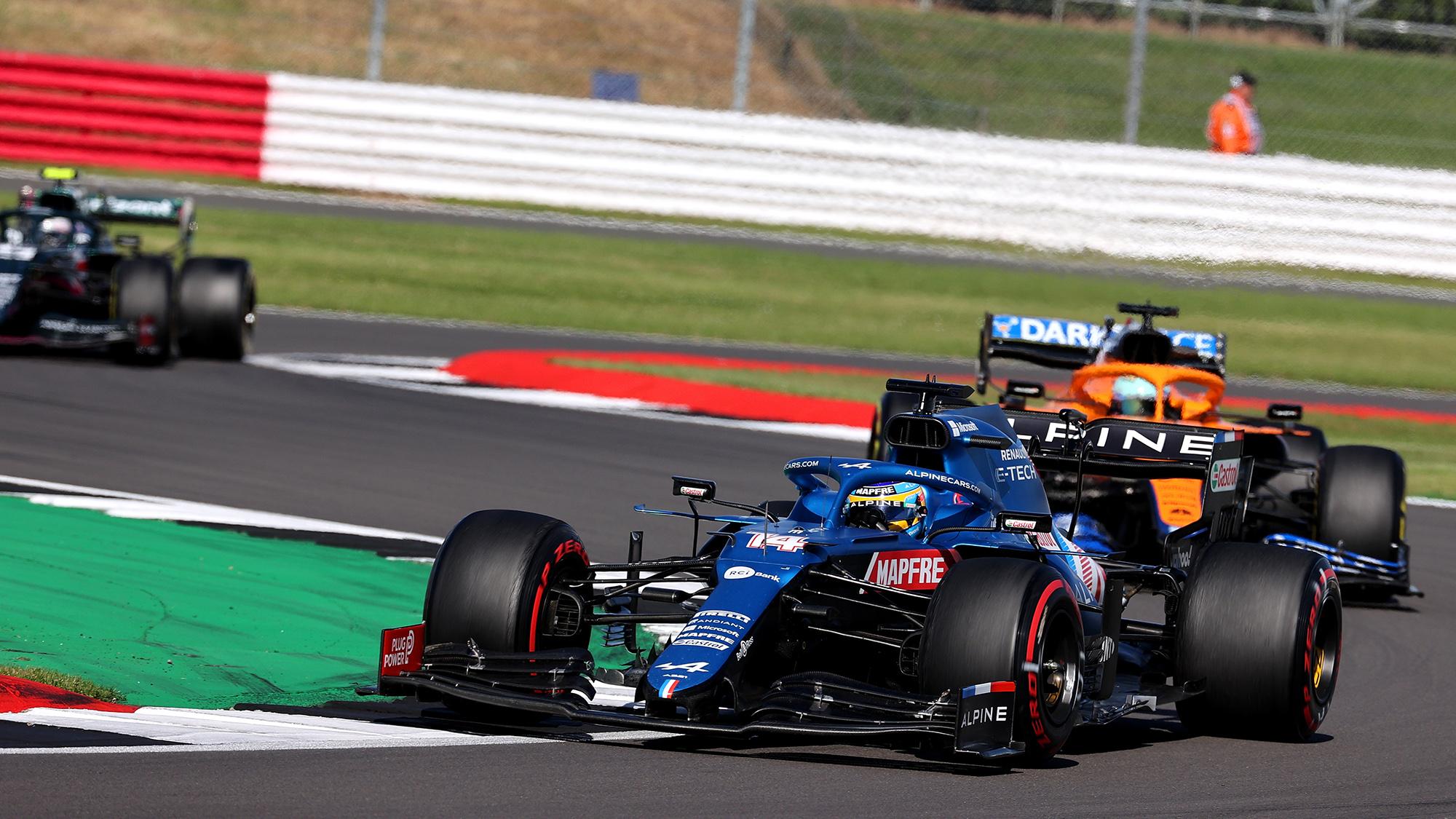 Fernando Alonso ahead of Daniel Ricciardo in the 2021 British Grand Prix