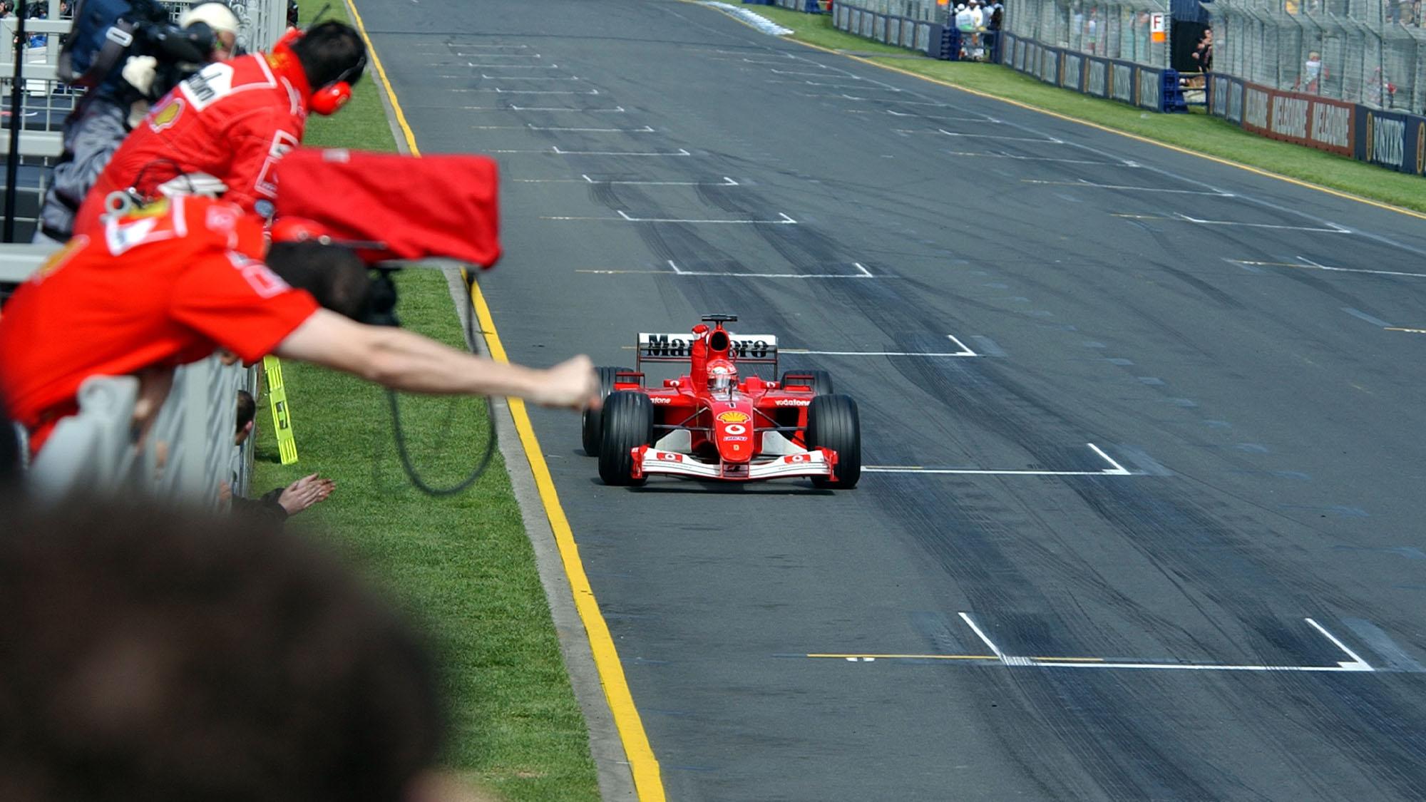 AUTO - F1 2002 - AUSTRALIA GP - MELBOURNE 20020303 - PHOTO: GILLES LEVENT / DPPI N¡ 1 - MICHAEL SCHUMACHER (GER) / FERRARI - ACTION FINISH LINE # 00000691_333